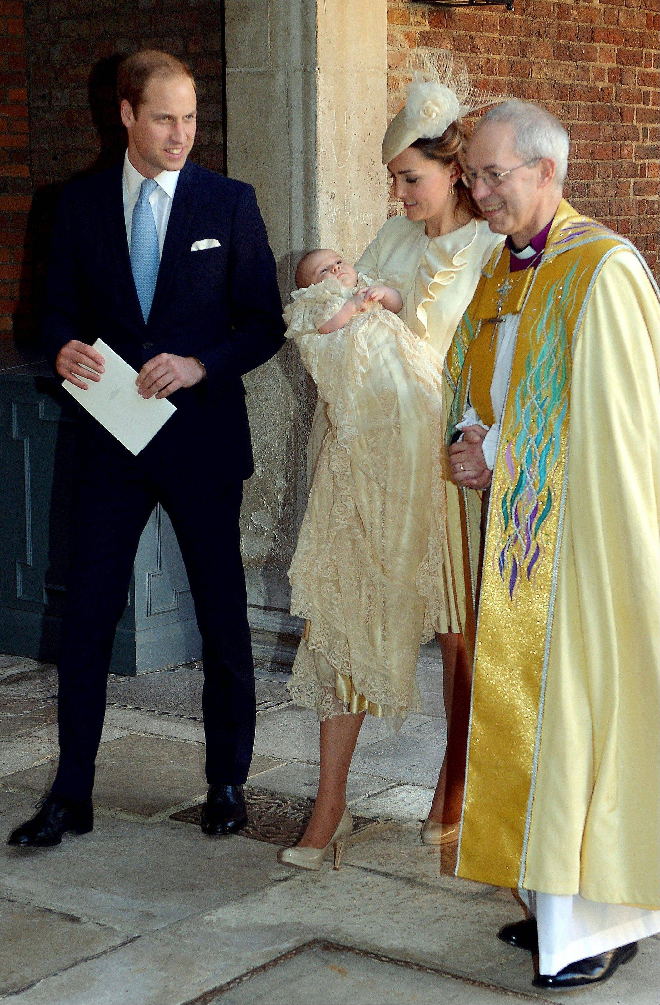Britain's Prince William, right, Kate Duchess of Cambridge with their son, Prince George, leave the Chapel Royal in St James' Palace in London, with the Archbishop of Canterbury Justin Welby after the christening of the 3-month-old Prince George.