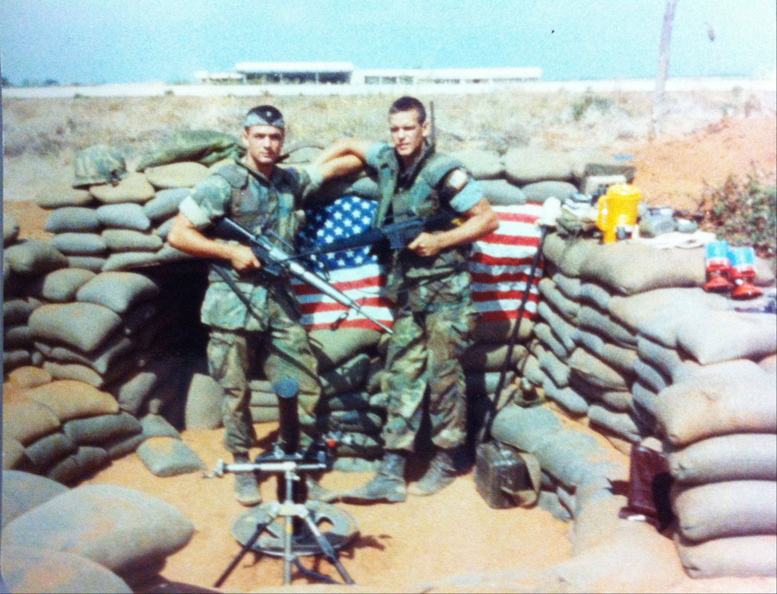 U.S. Marines PFC John Sexton, left, and Lance Cpl. Randy Lund manning a mortar pit on the perimeter of the Beirut International Airport in 1983.