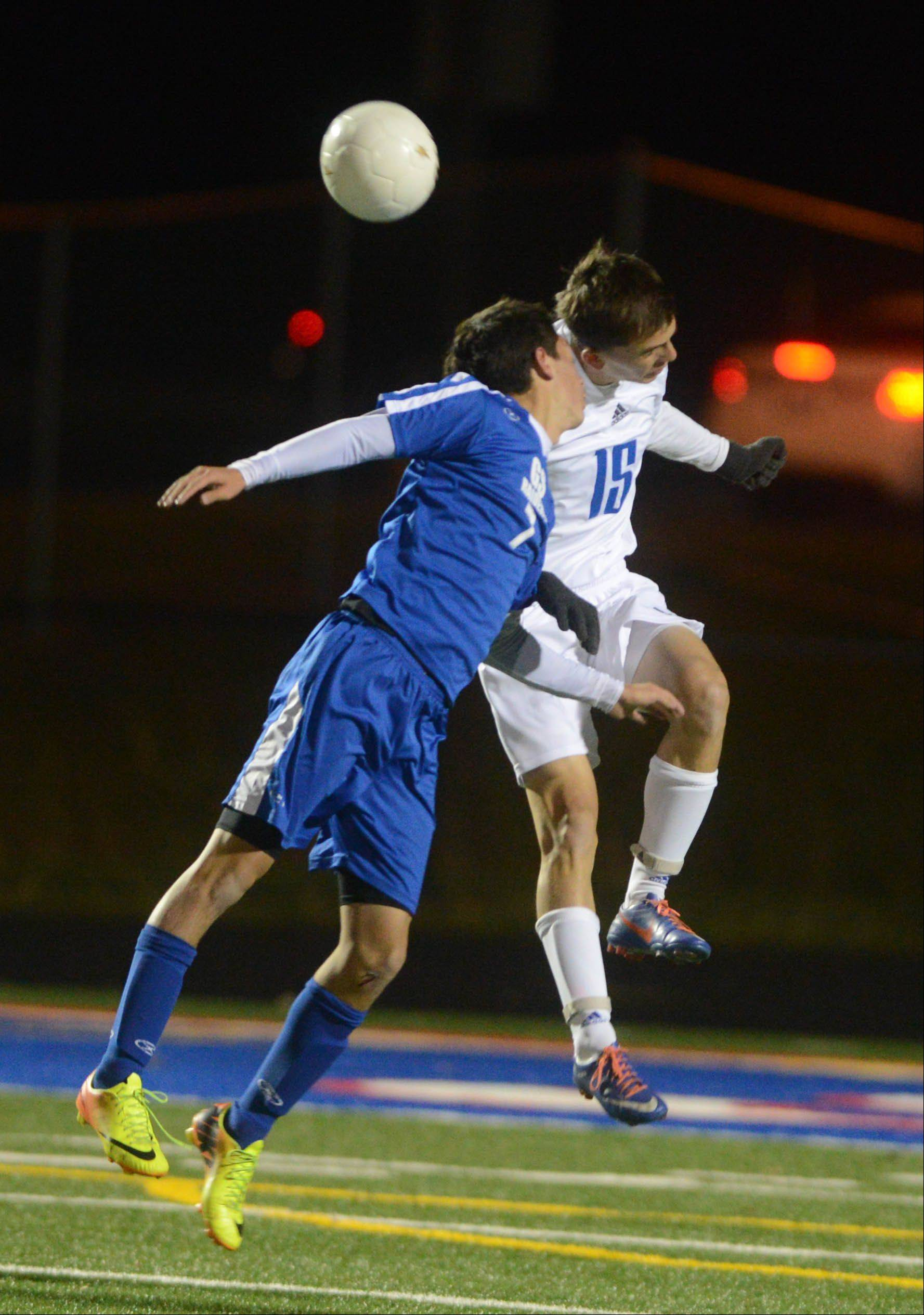 Jonathan Gutierrez of Glenbard South,left, and Paul Plizga of Fenton go up for a ball during the Fenton at Glenbard South boys soccer Class 2A regional semifinal game Wednesday.