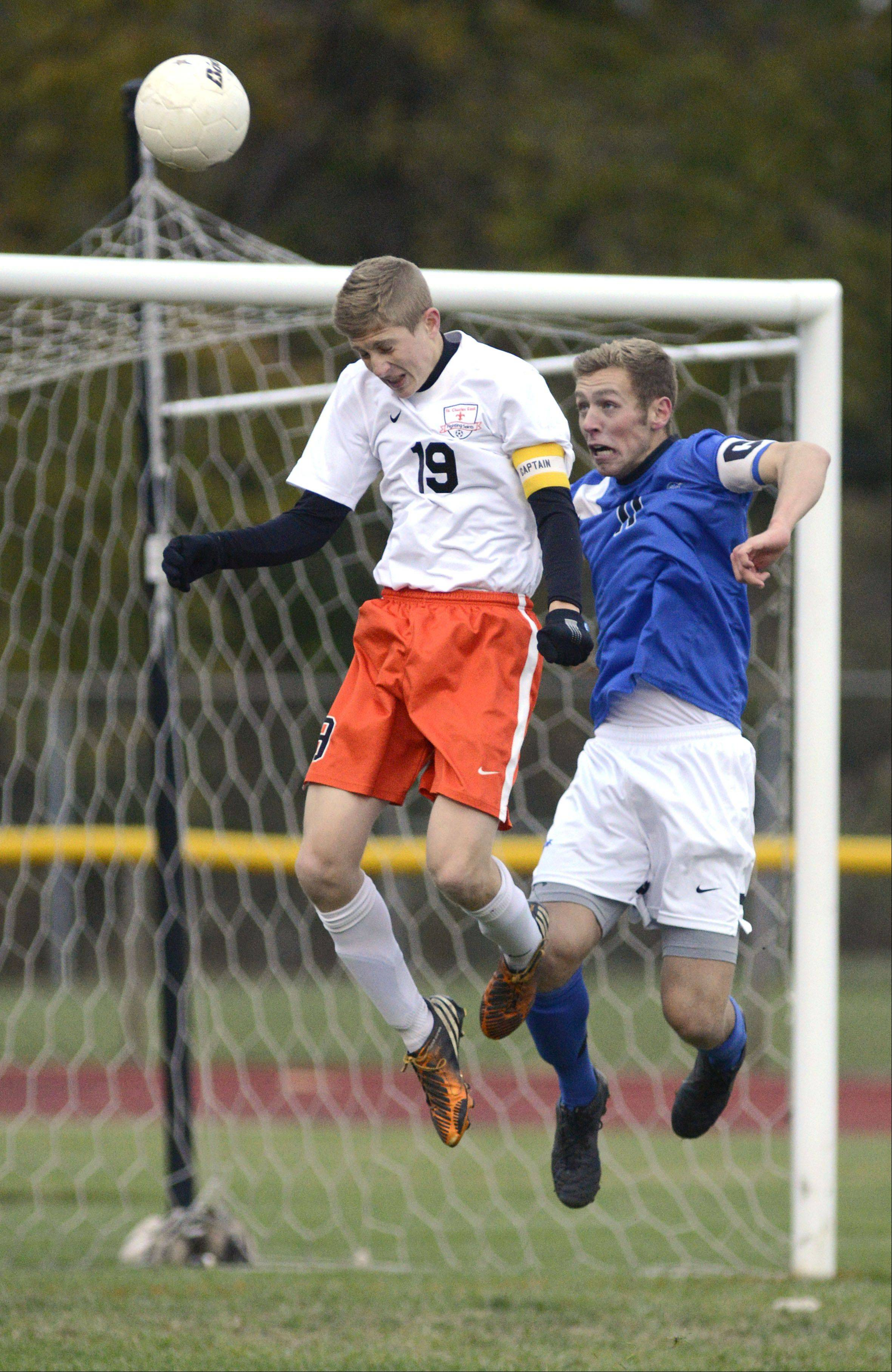 St. Charles East's Andrew Shone and St. Charles North's Phillip LeGare fight to head the ball in the second half on Wednesday, October 23.