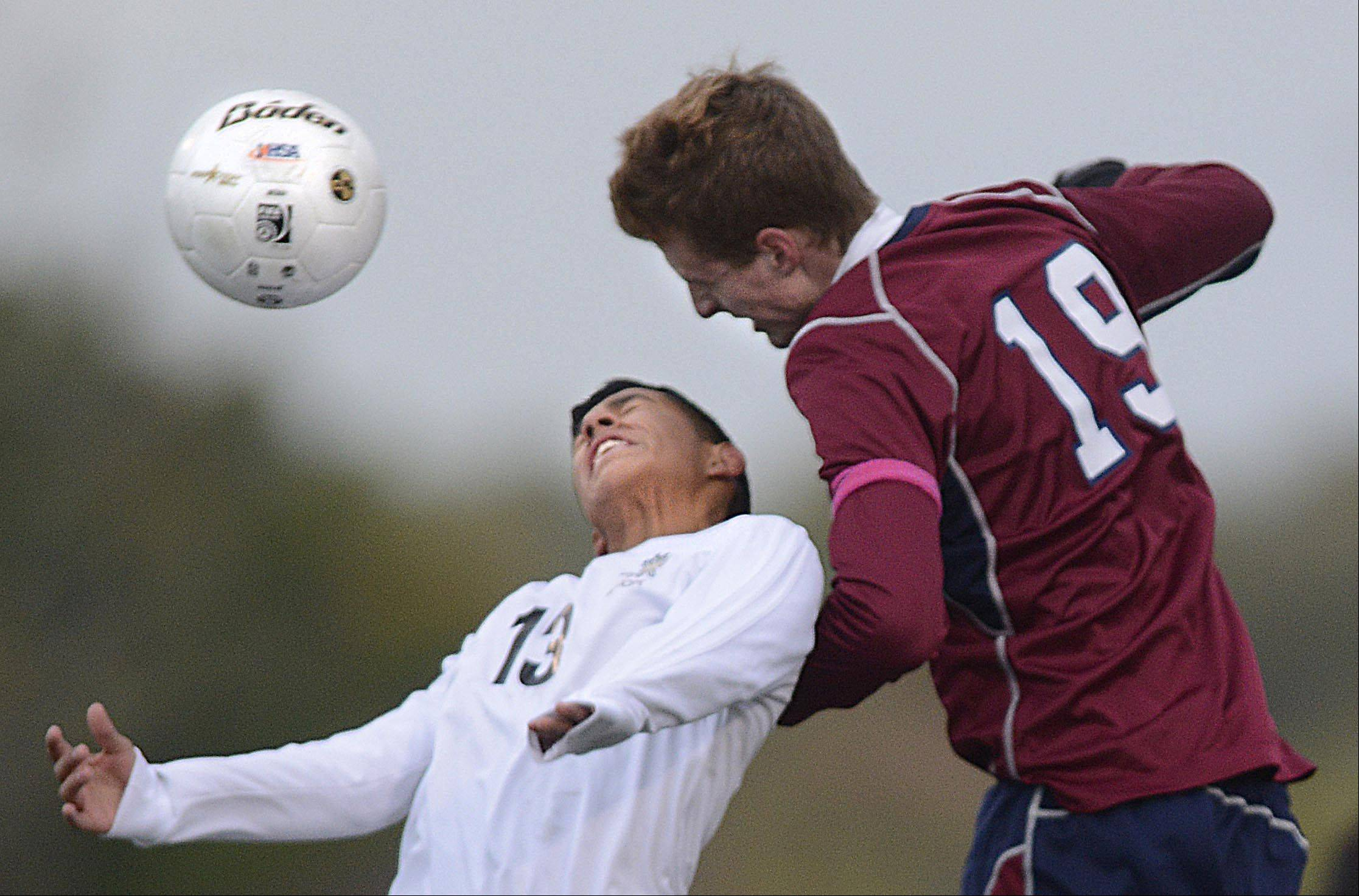 Streamwood's Donnie Sosa and South Elgin's Owen Bott, right, compete for a header Wednesday at Millennium Field in Streamwood.