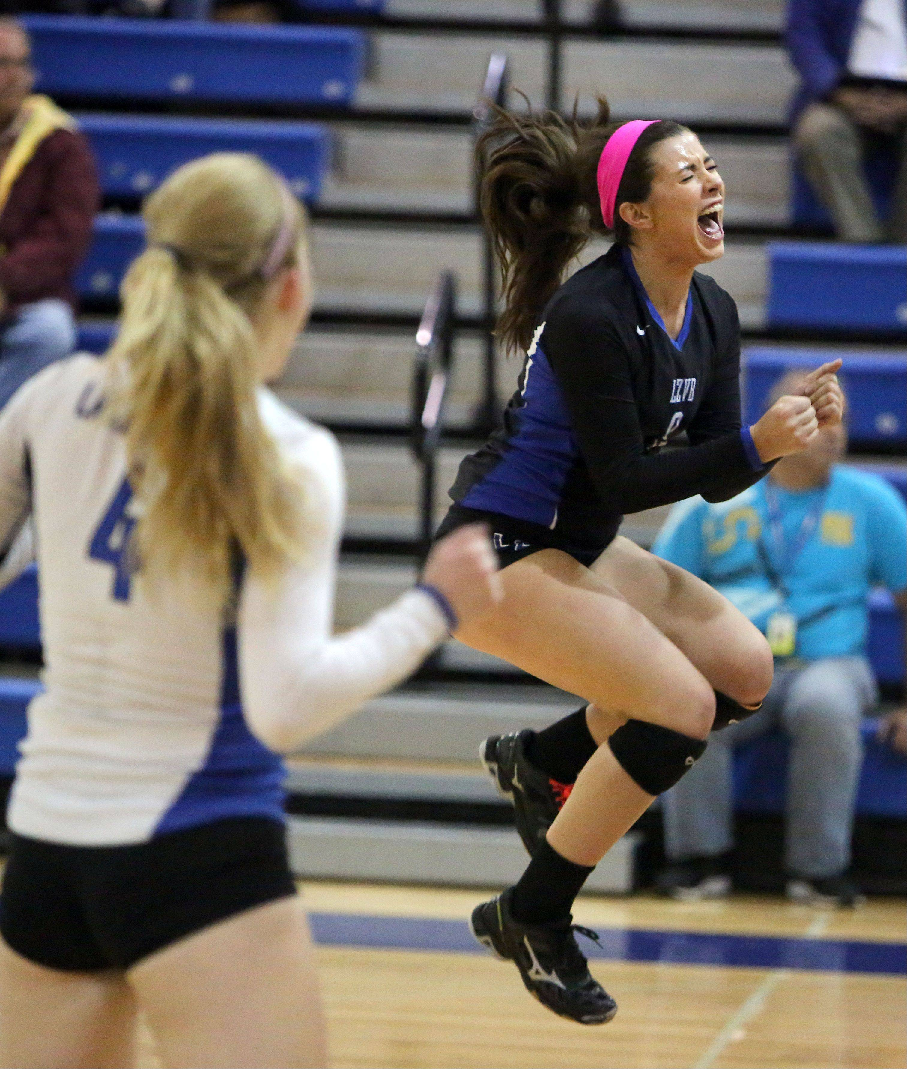 Lake Zurich's Ashley Dina celebrates after winning a point during the Bears' NSC title win over host Lakes on Wednesday night.