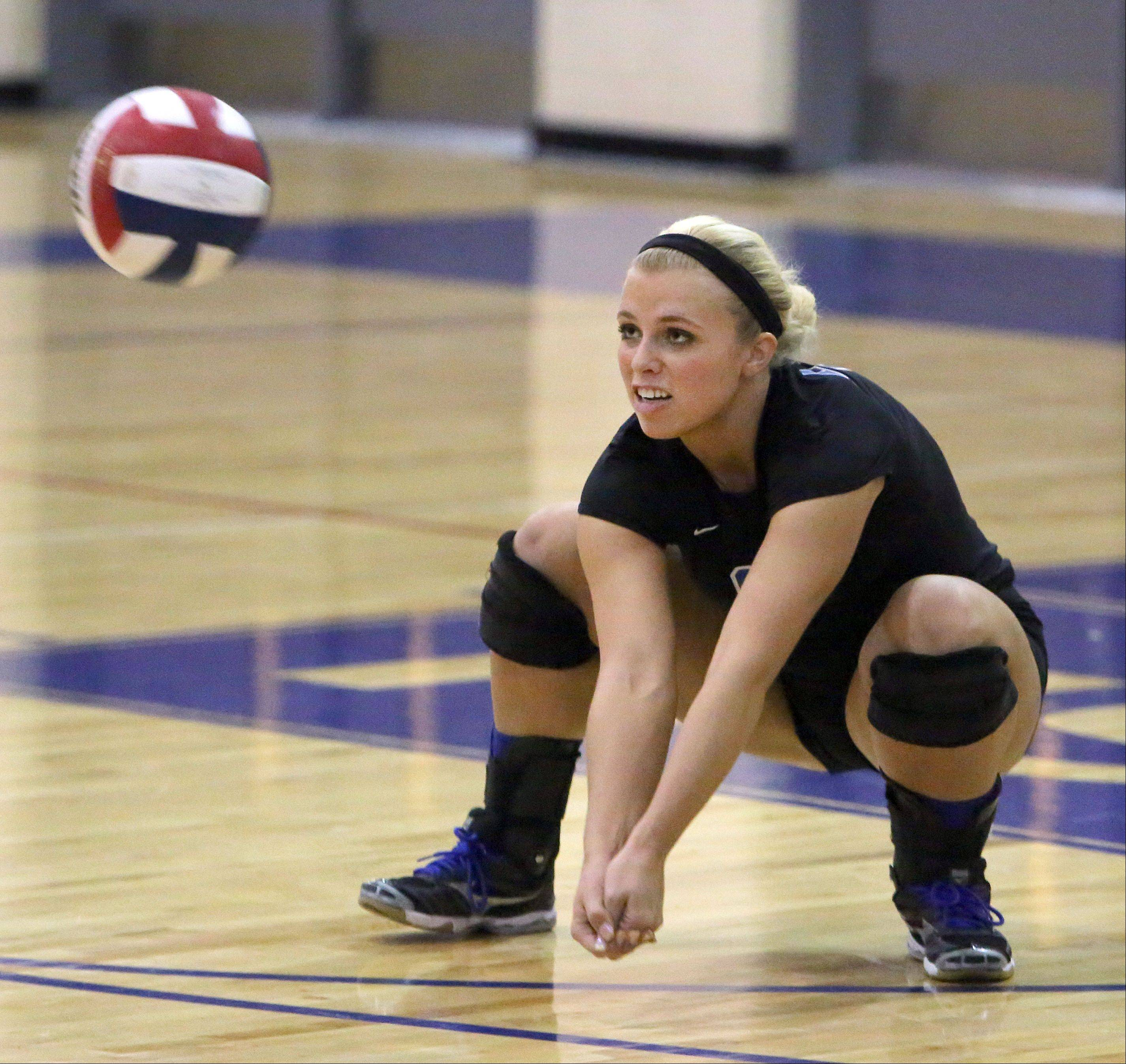 Lakes' Lisa Buehler digs out a serve during the NSC title game against Lake Zurich Wednesday night at Lakes High School.