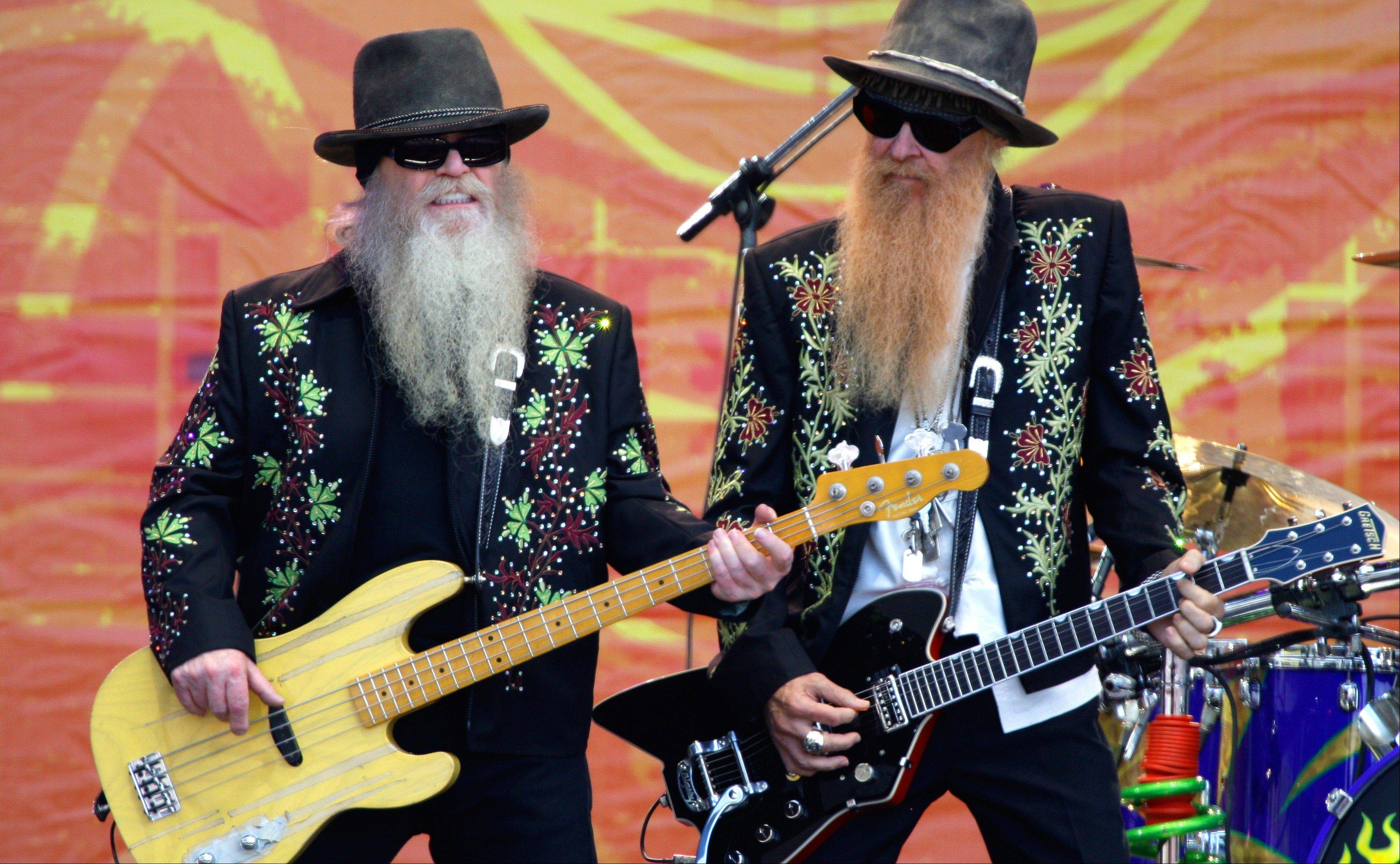 Dusty Hill, left, and Billy Gibbons of ZZ Top perform during the 2010 Crossroads Guitar Festival in Chicago.