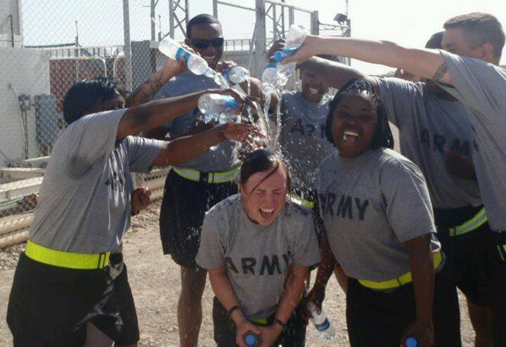 PHOTO CAPTION: First Lieutenant Corinne Noble is congratulated by her soldiers for her 3rd place finish in the Camp Leatherneck (Afghanistan) 5K.