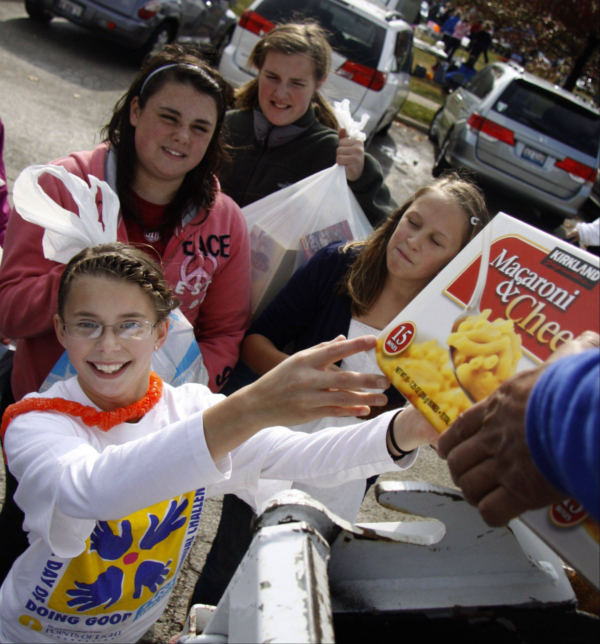 Volunteers hope to collect more than 40,000 pounds of food Saturday during Wheaton�s annual �Stuff-a-Truck with Food� drive as part of the city�s Make a Difference Day celebration.