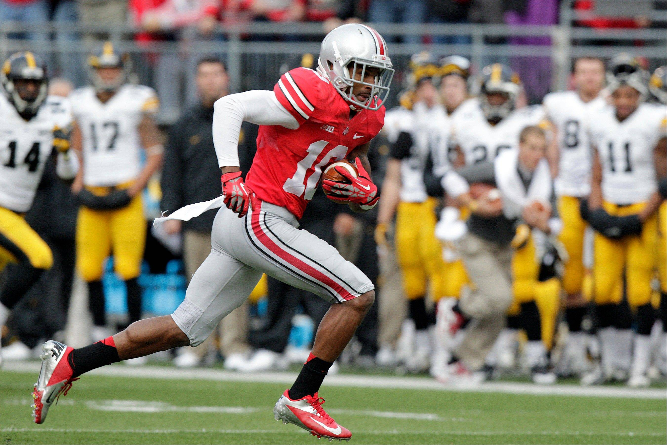 Ohio State wide receiver Corey Brown runs against Iowa during last Saturday�s game in Columbus, Ohio. Brown gave stirring, adults-only halftime speech last week that lifted the Buckeyes to yet another victory.