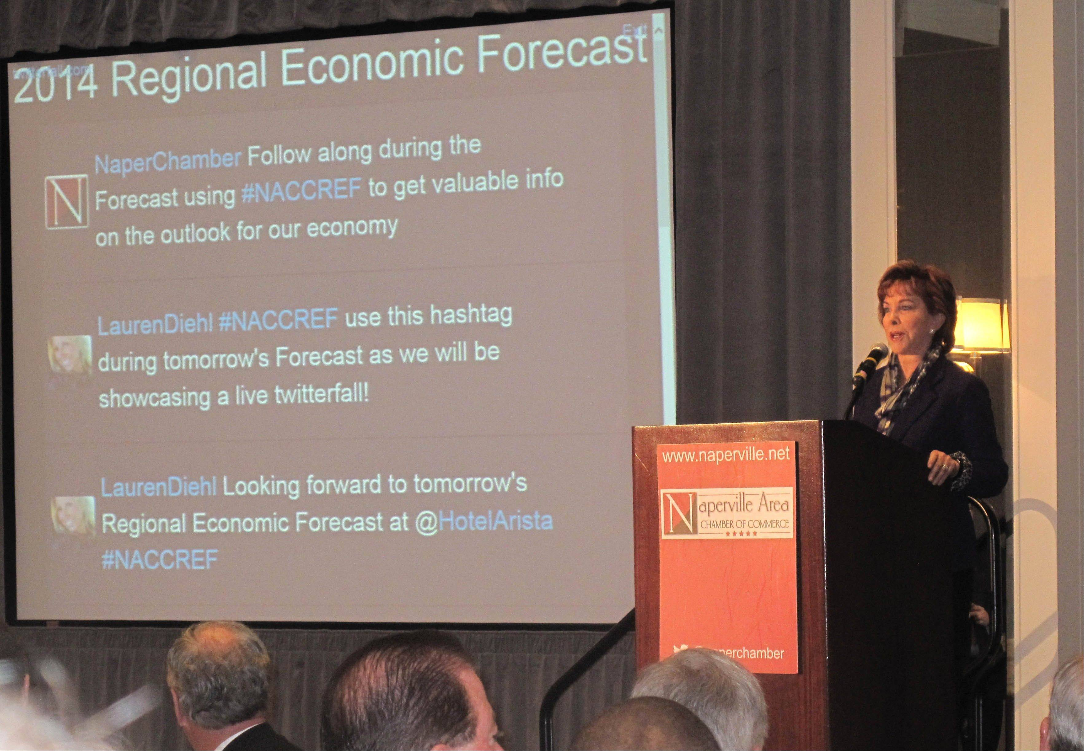 Terry Savage, personal finance expert and moderator of the Naperville Area Chamber of Commerce's annual Regional Economic Forecast, announces Thursday's panel before an audience of business leaders at Hotel Arista.