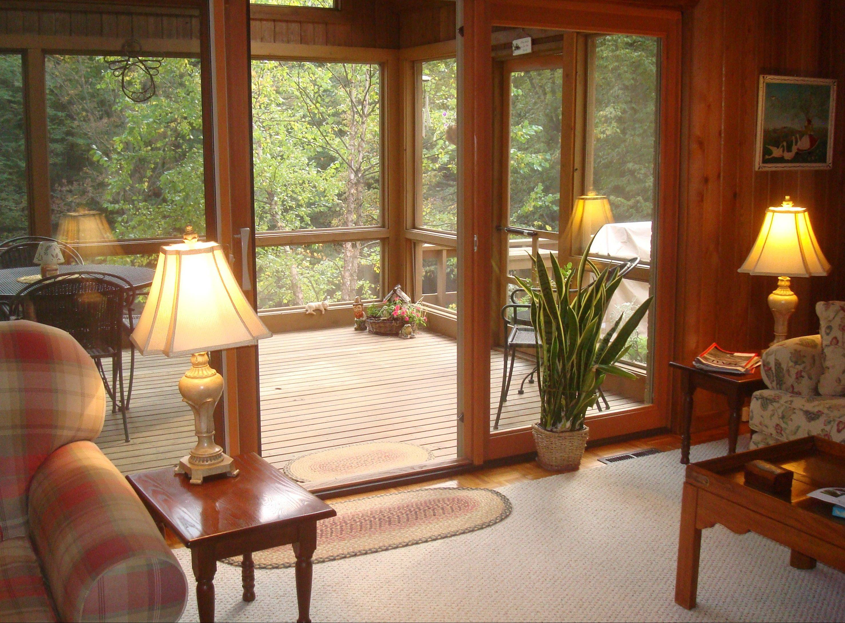 A three-season home is a perfect setting to enjoy the wooded surroundings.