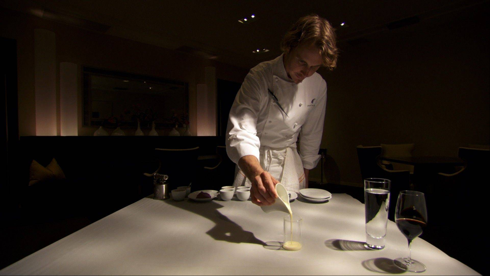 "Grant Achatz, chef of Chicago's famous Alinea restaurant, puts final artistic touches on a dessert in the doc ""Spinning Dishes."""
