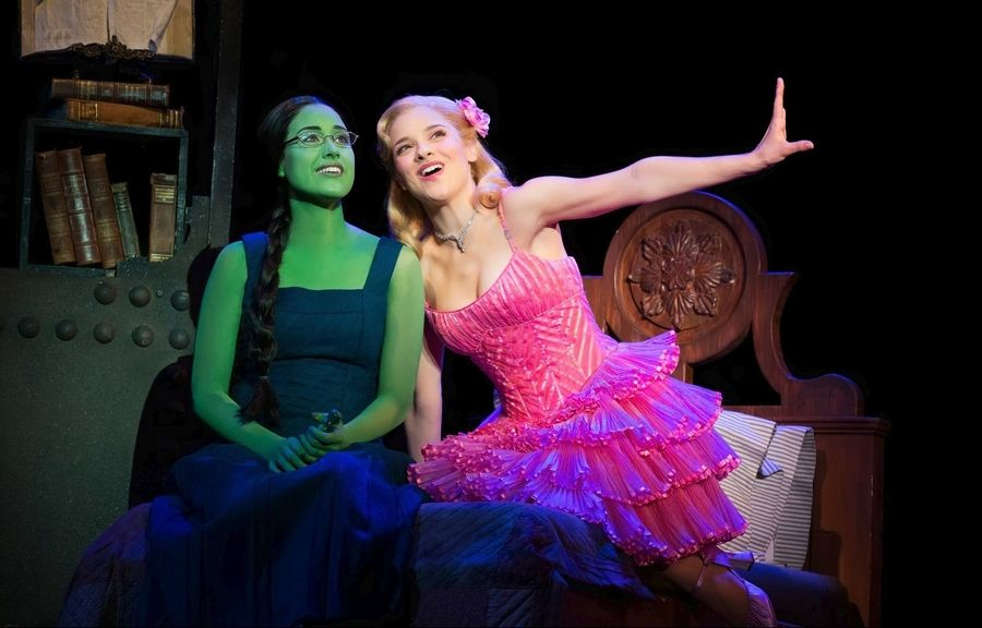 "Glinda (Jenn Gambatese), right, gives advice to Elphaba (Alison Luff) on how to be ""Popular"" in the Emerald City national tour of ""Wicked,"" playing at the Oriental Theatre in Chicago from Wednesday, Oct. 30, through Sunday, Dec. 21."