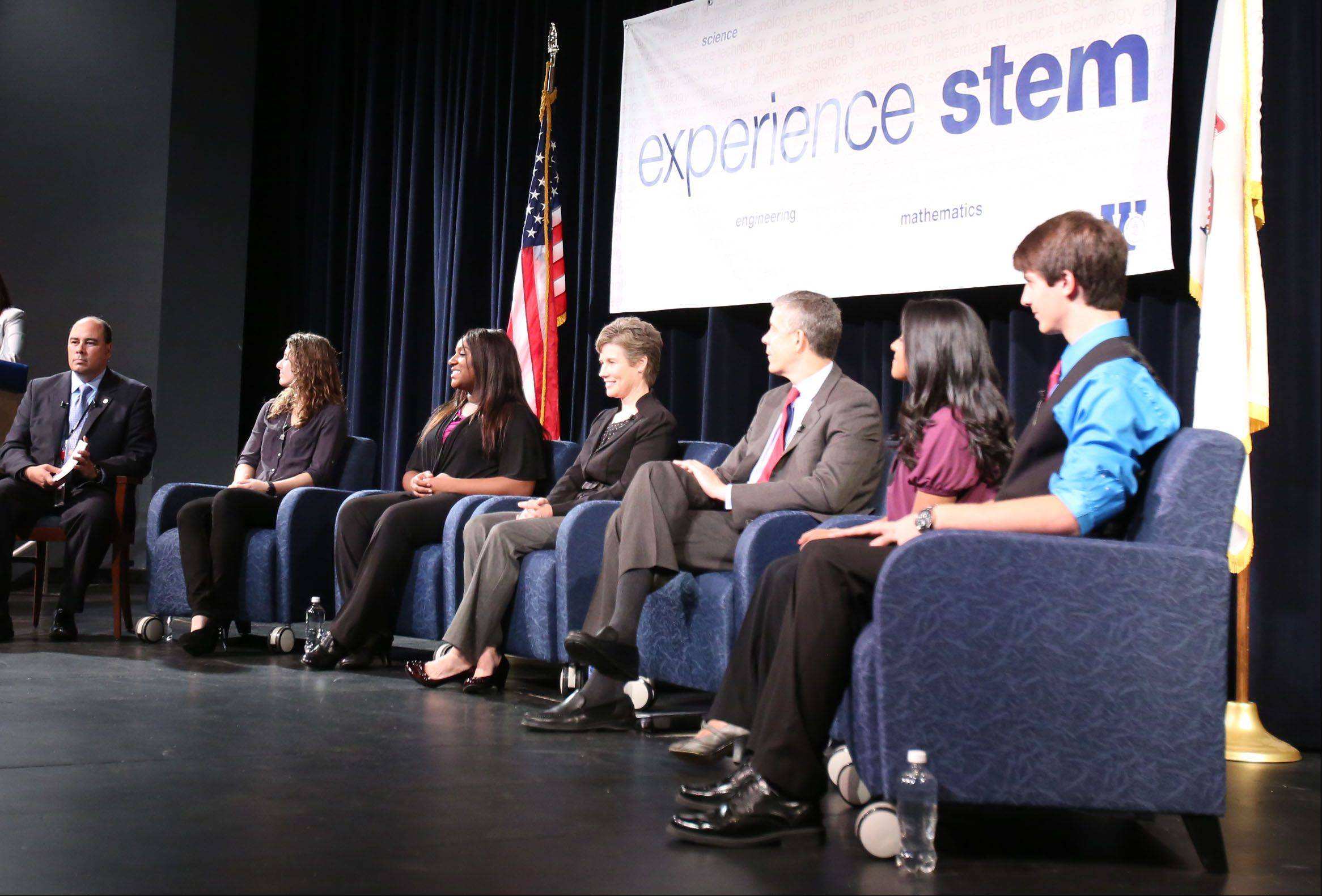 Dr. Lazaro Lopez, associate superintendent of Northwest Suburban High School District 214, speaks during a panel discussion on science, technology, engineering, and mathematics education at Wheeling High School with Secretary of Education Arne Duncan.