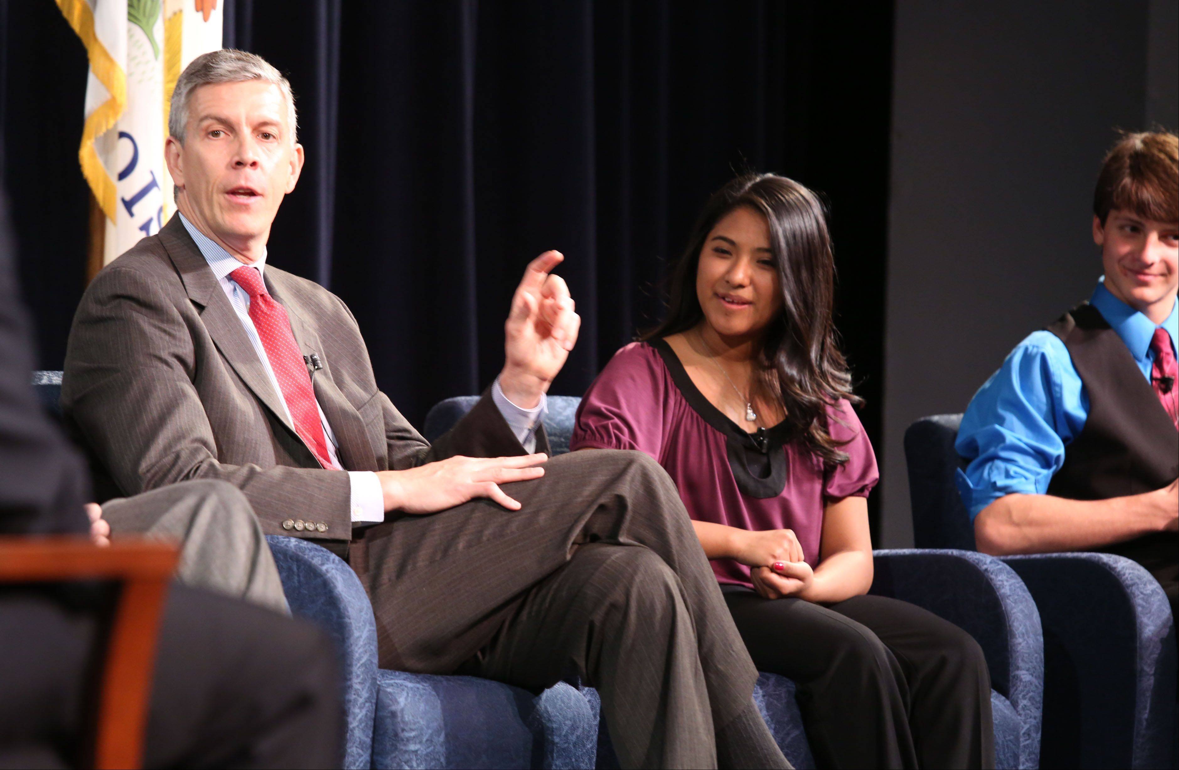 Secretary of Education Arne Duncan speaks during at a panel discussion on STEM education with Wheeling High School seniors Venessa Reyes and Nicholas Gross.