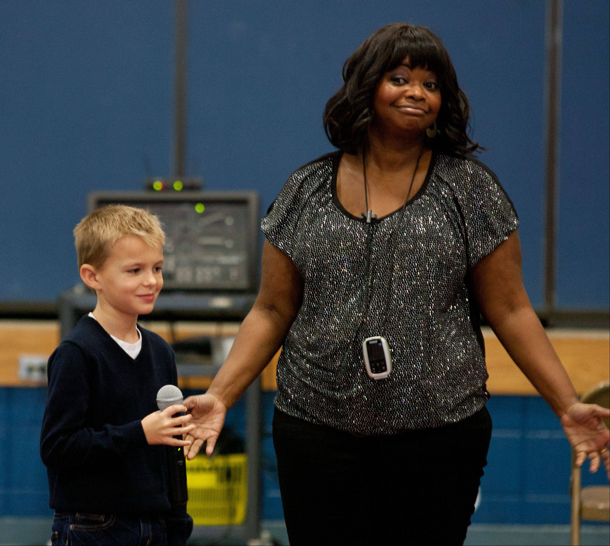 "Actress Octavia Spencer, who won an Academy Award for her role in ""The Help,"" answers questions Thursday from students at Young Elementary School in Aurora, including third-grader Jack Raskovich."