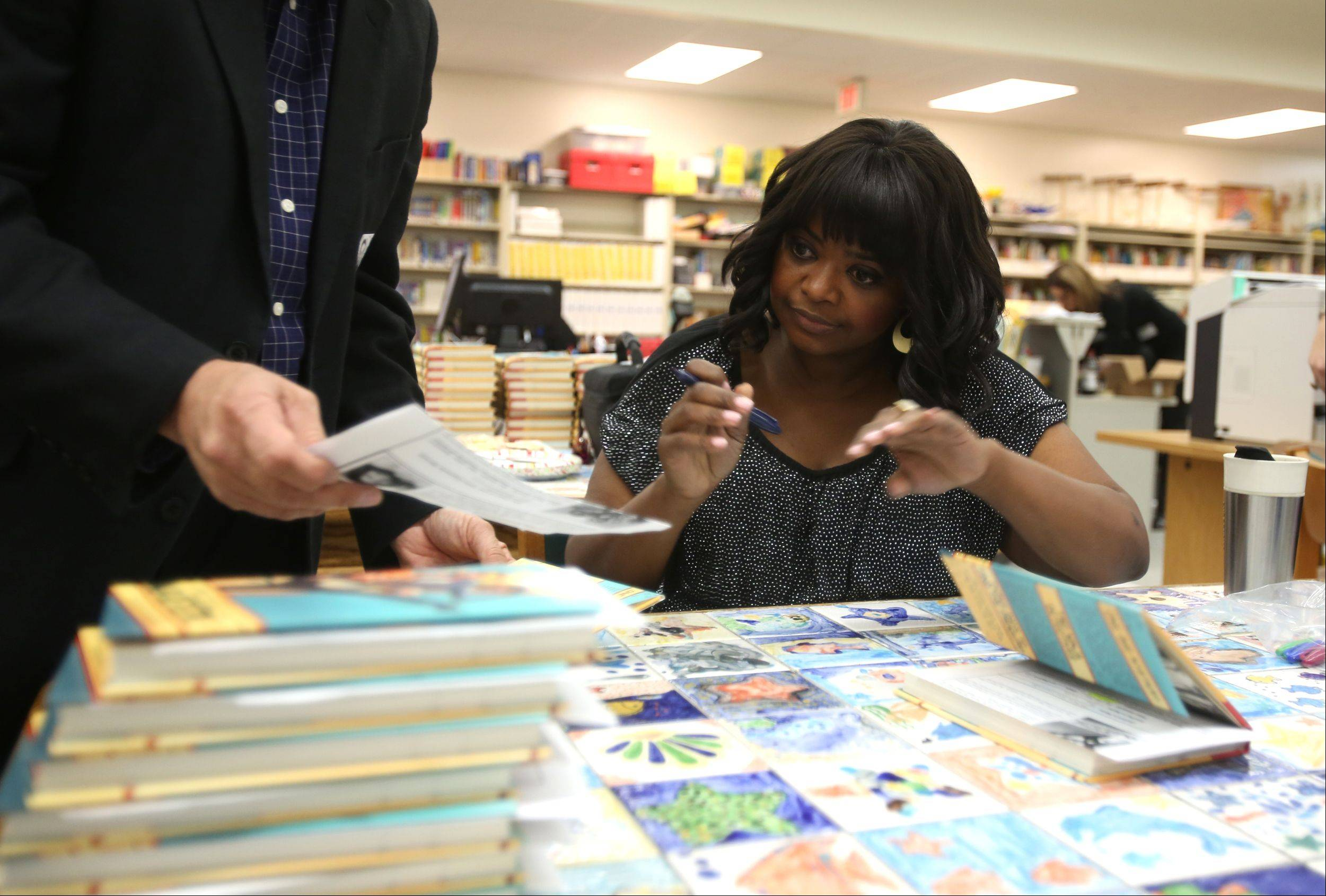 "Octavia Spencer signs her book ""Randi Rhodes, Ninja Detective: The Case of the Time Capsule Bandit,"" at Young Elementary School."