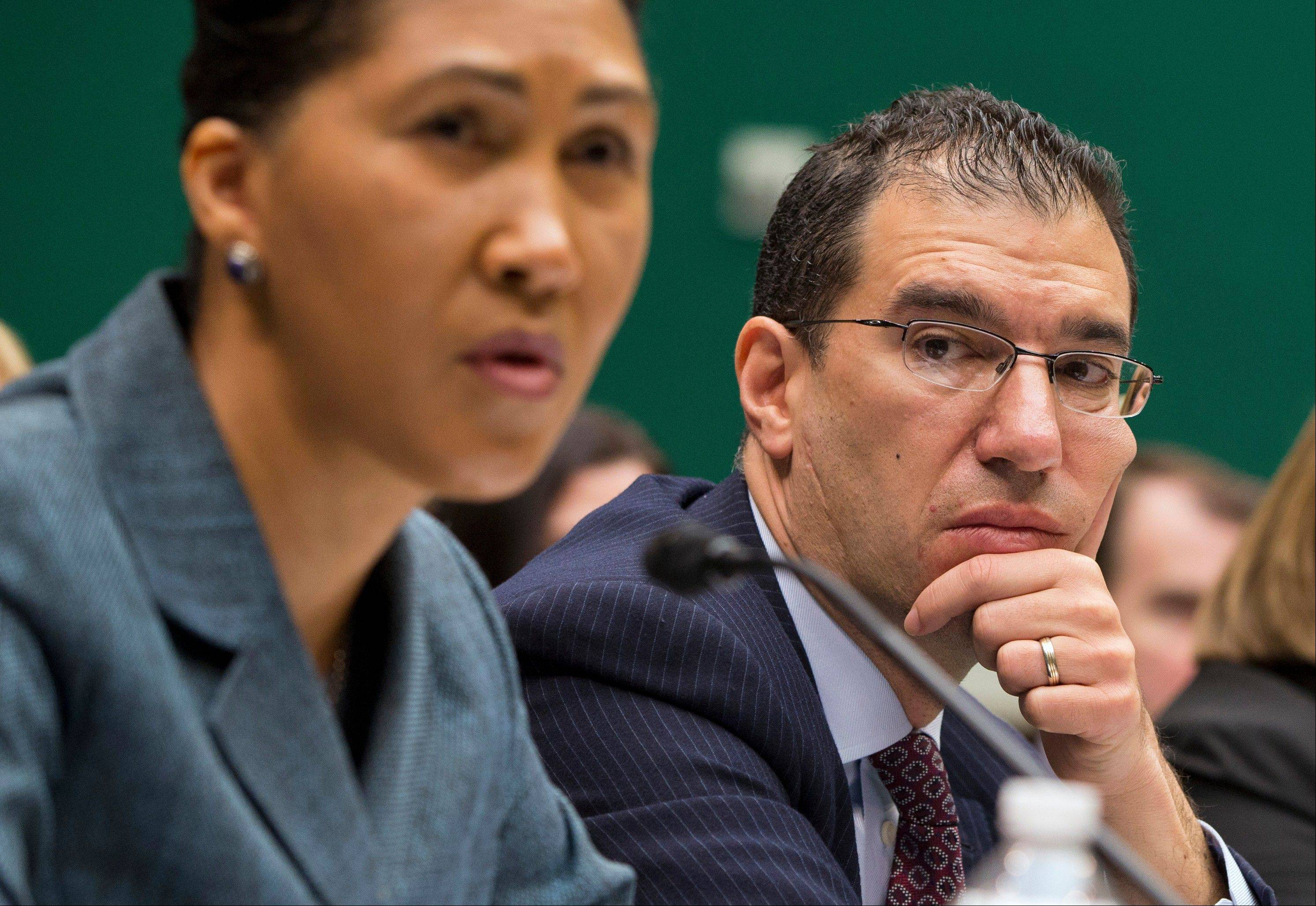 Andrew Slavitt, group executive vice president for Optum/QSSI, listens at right as Cheryl Campbell, senior vice president of CGI Federal, testifies on Capitol Hill Thursday. The hearing heard from contractors that built the federal government's health care websites.