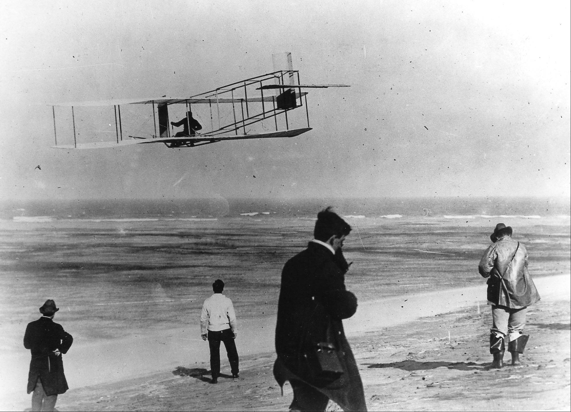 Orville and Wilbur Wright test their airplane on a beach. The Wright brothers have long been credited as the first to achieve powered flight. But in June, 2013, Connecticut Gov. Dannel P. Malloy signed a law giving German-born aviator and Connecticut resident Gustave Whitehead the honor of being first.