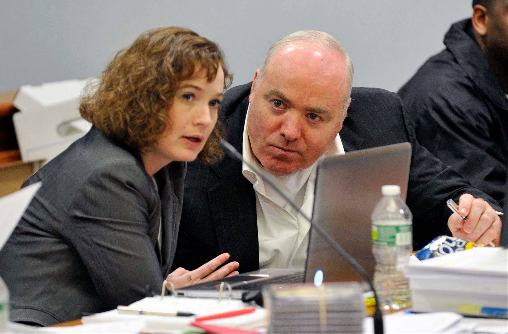In a Friday, April 26, 2013 photo, Michael Skakel, right, talks to Jessica Santos, one of his defense attorneys, during his appeal at State Superior Court in Vernon, Conn.