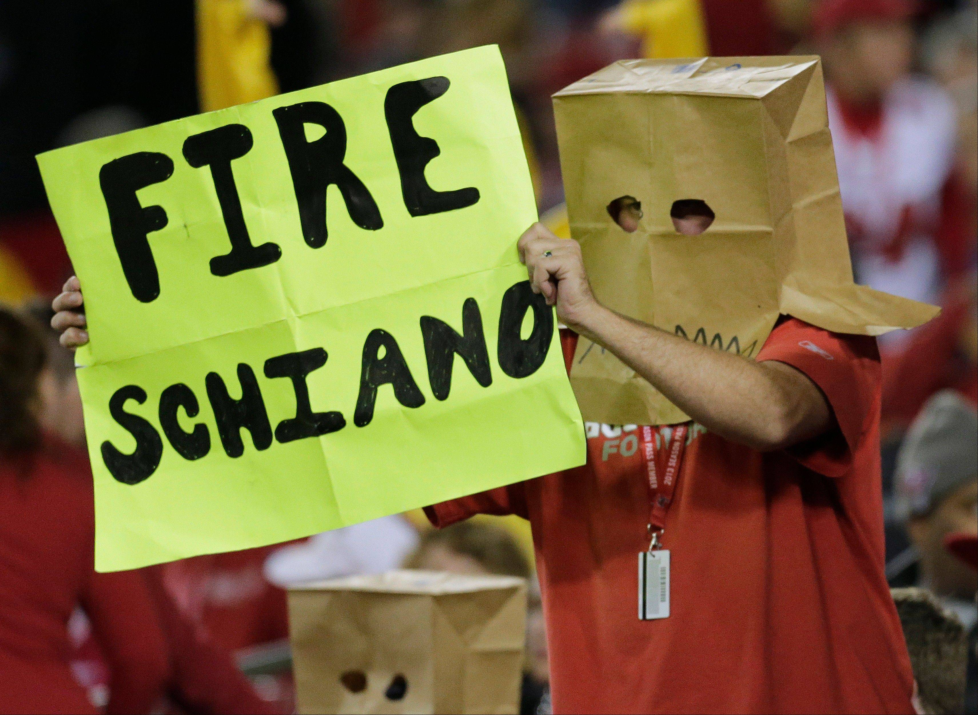 A Buccaneers fan displays the sentiment of many in Tampa. The Buccaneers have lost 12 of 13 dating back to last season, ratcheting up the pressure on second-year head coach Greg Schiano.