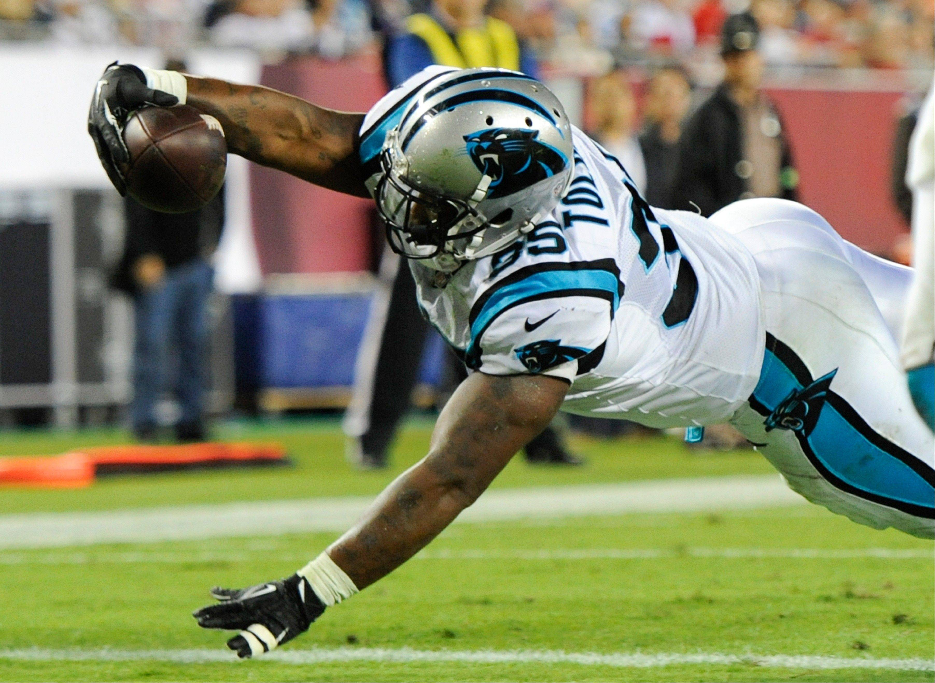 Carolina Panthers fullback Mike Tolbert dives over the goal line on a 3-yard touchdown pass play against the Tampa Bay Buccaneers on Thursday night.