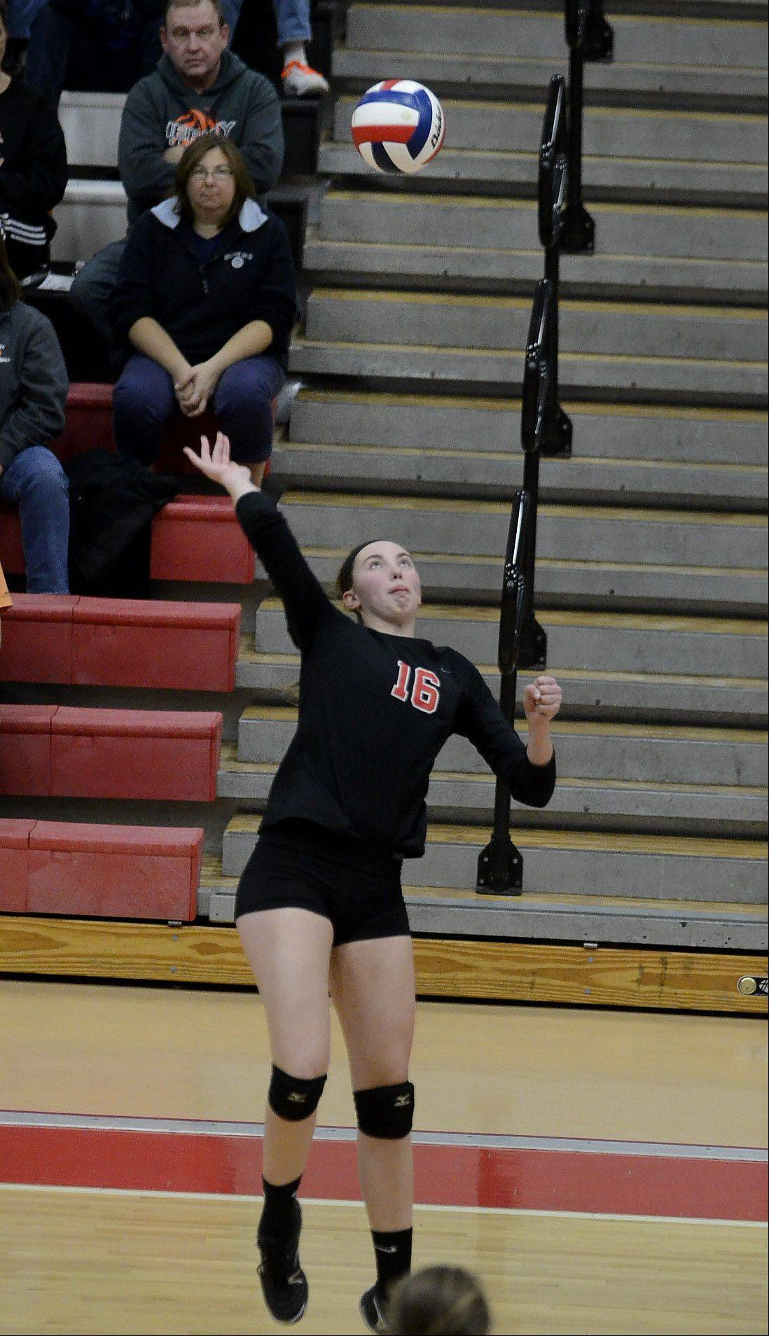 Barrington's Megan Talbot goes up high for a spike against Hersey in the Mid-Suburban League girls volleyball championship matchup.