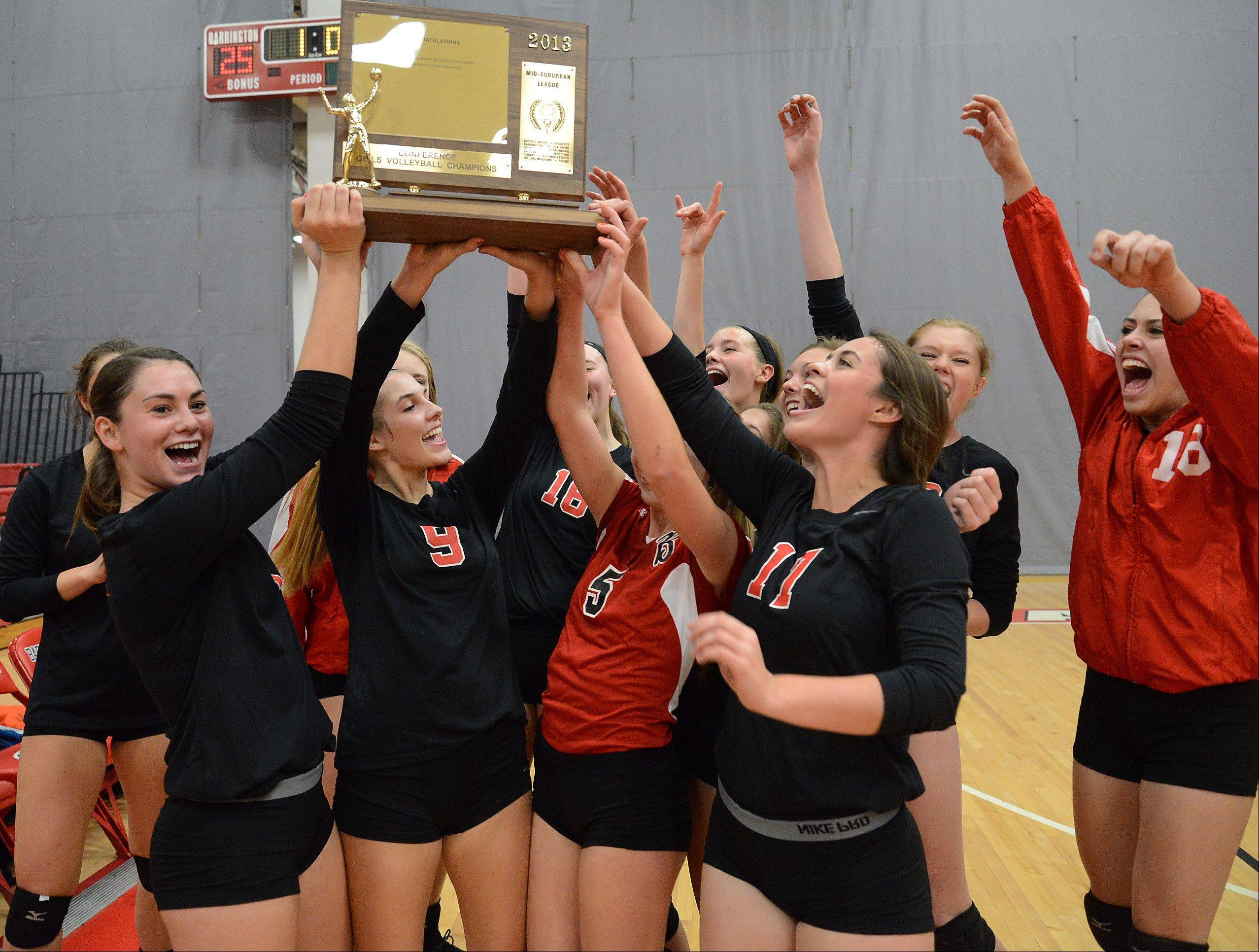 Barrington girls hoist the trophy after topping Hersey in the Mid-Suburban League girls volleyball championship matchup.