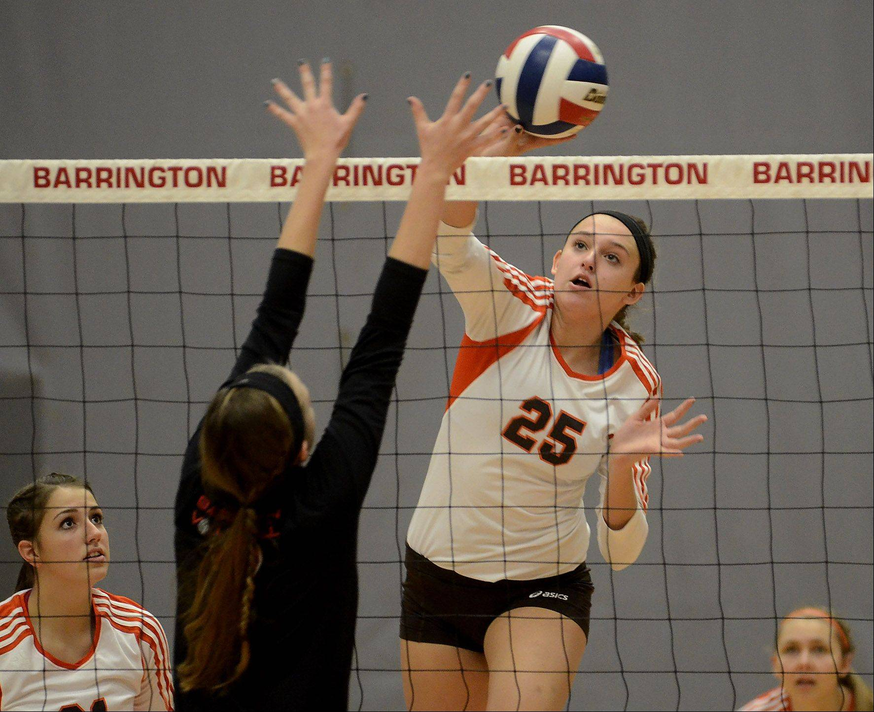 Hersey's Gabri Olhava tries a tip opposite Barrington's Claire Waliczek in Thursday's Mid-Suburban League girls volleyball championship matchup.