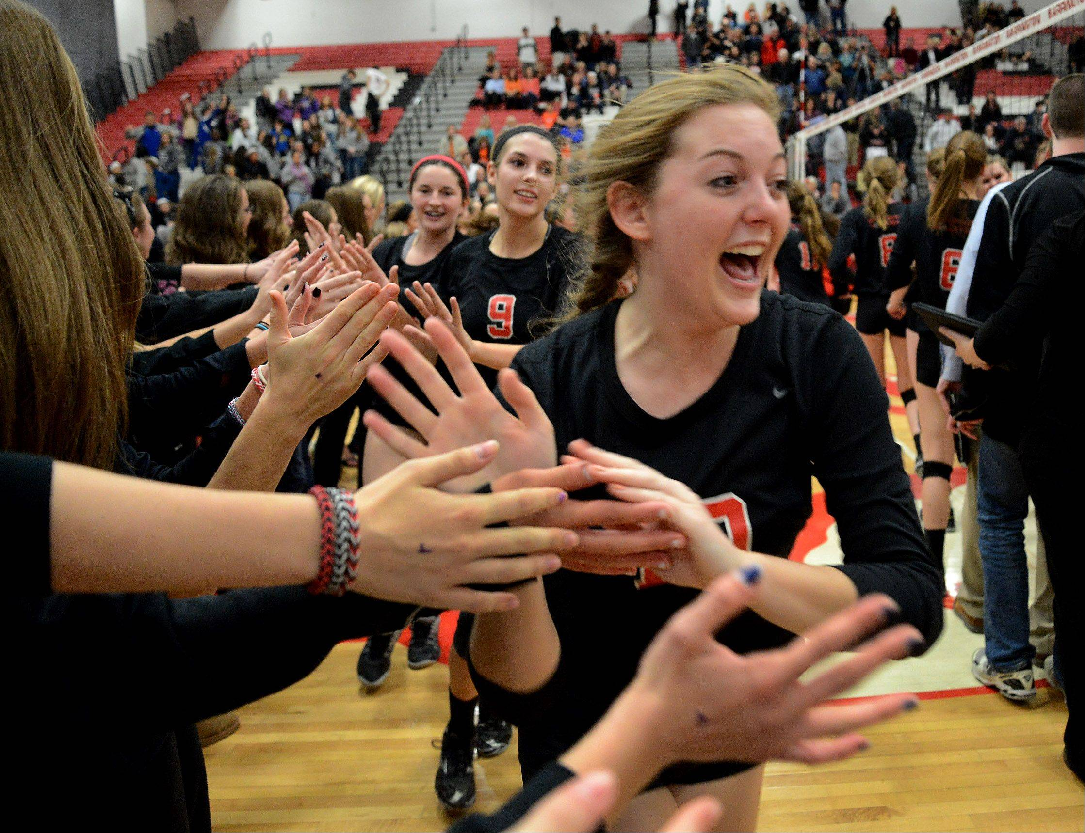 Emma French celebrates with teammates after Barrington defeated Hersey in the Mid-Suburban League girls volleyball championship matchup.