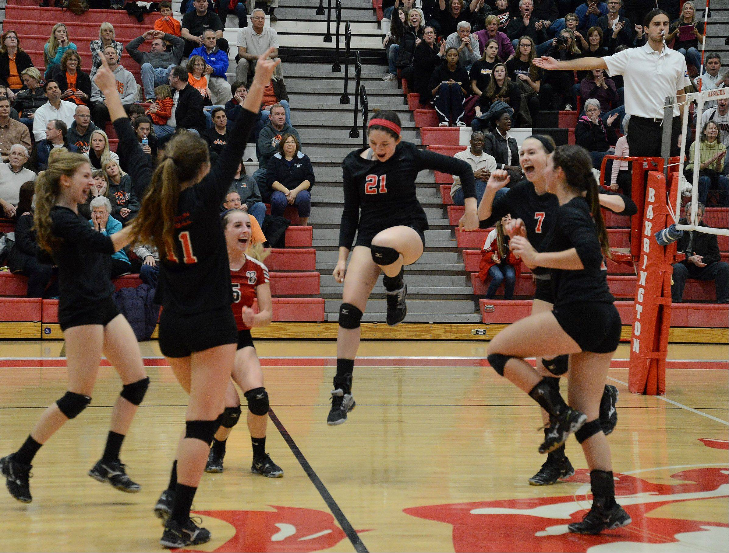 Barrington celebrates the final point after beating Hersey in the Mid-Suburban League girls volleyball championship matchup.