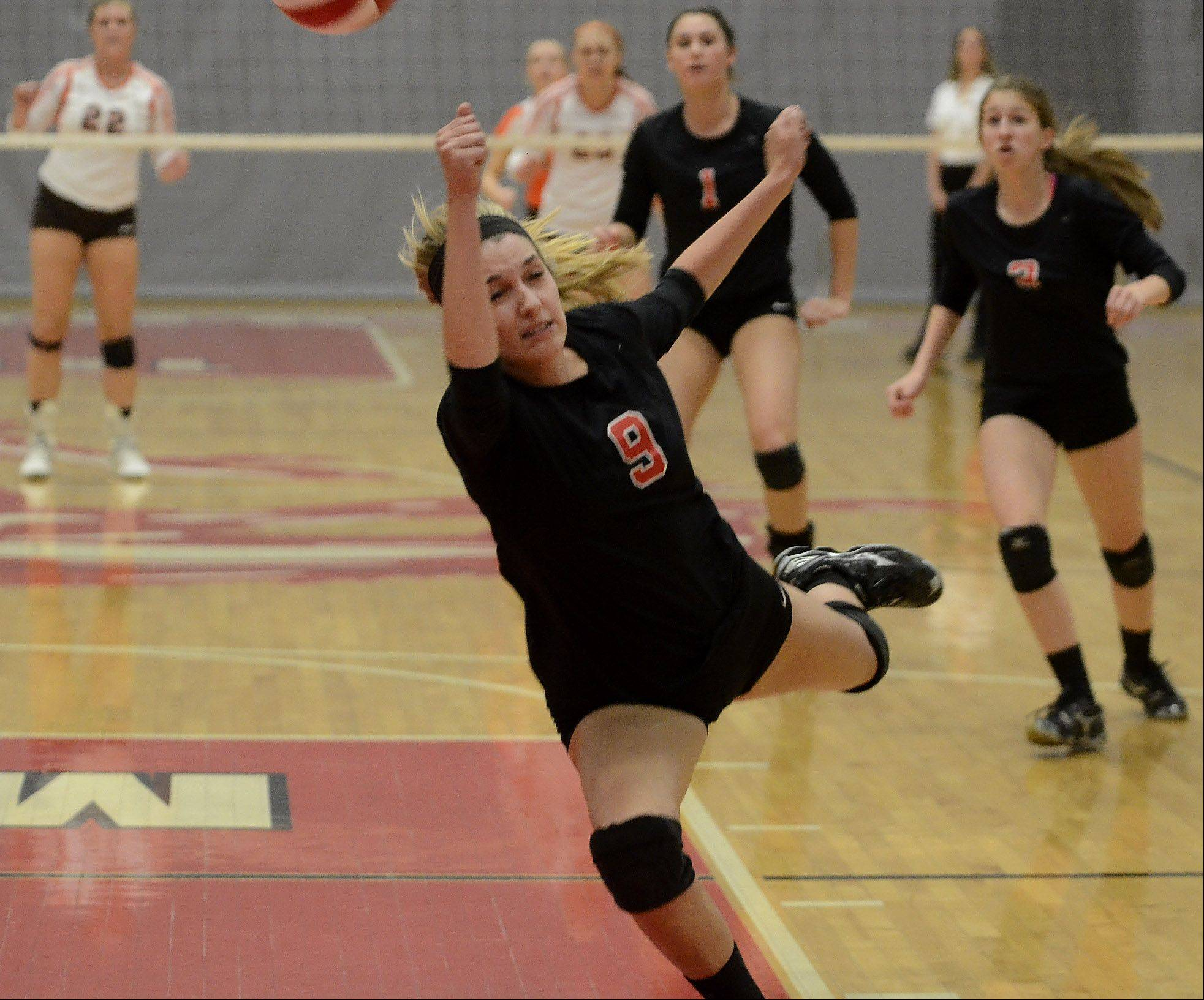 Barrington's Emily Watkins chases a ball down against Hersey in Thursday's Mid-Suburban League girls volleyball championship matchup.