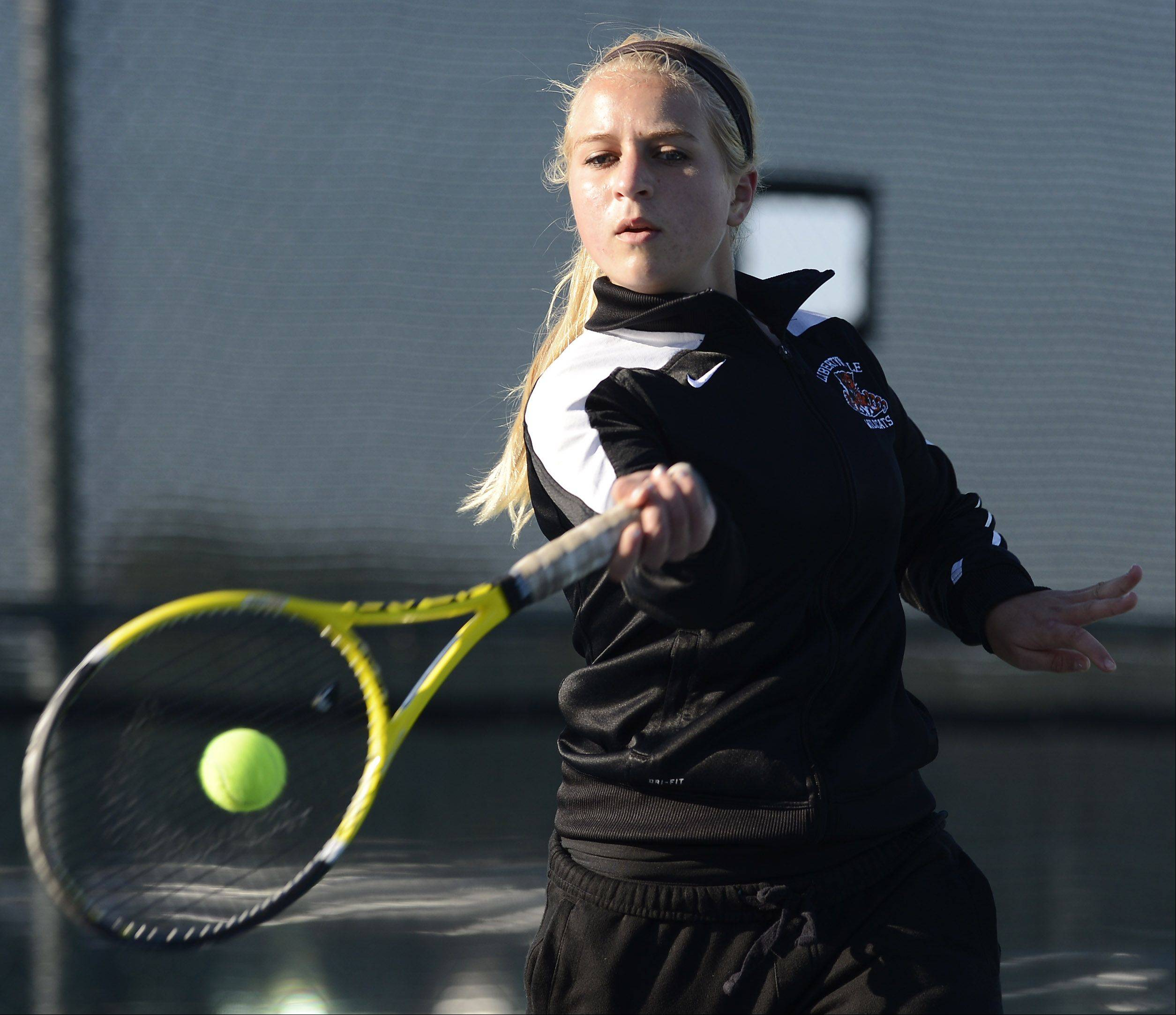 Libertyville's Aleksandra Grabowski returns a volley during the girls tennis state tournament at Prospect High School on Thursday.