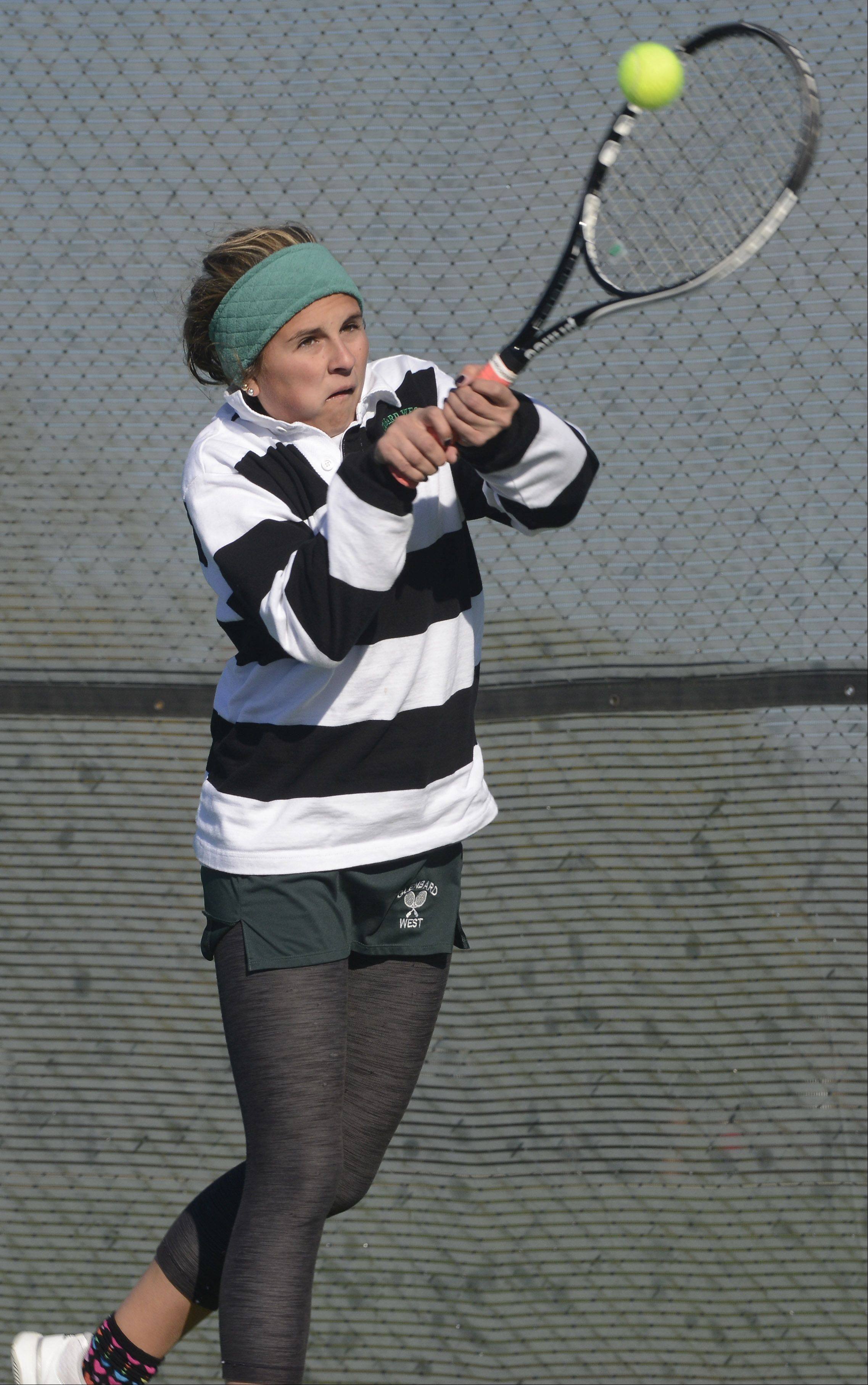 Glenbard West's Maggie Hughes returns a smash during the girls state tennis preliminaries at Prospect High School Thursday.