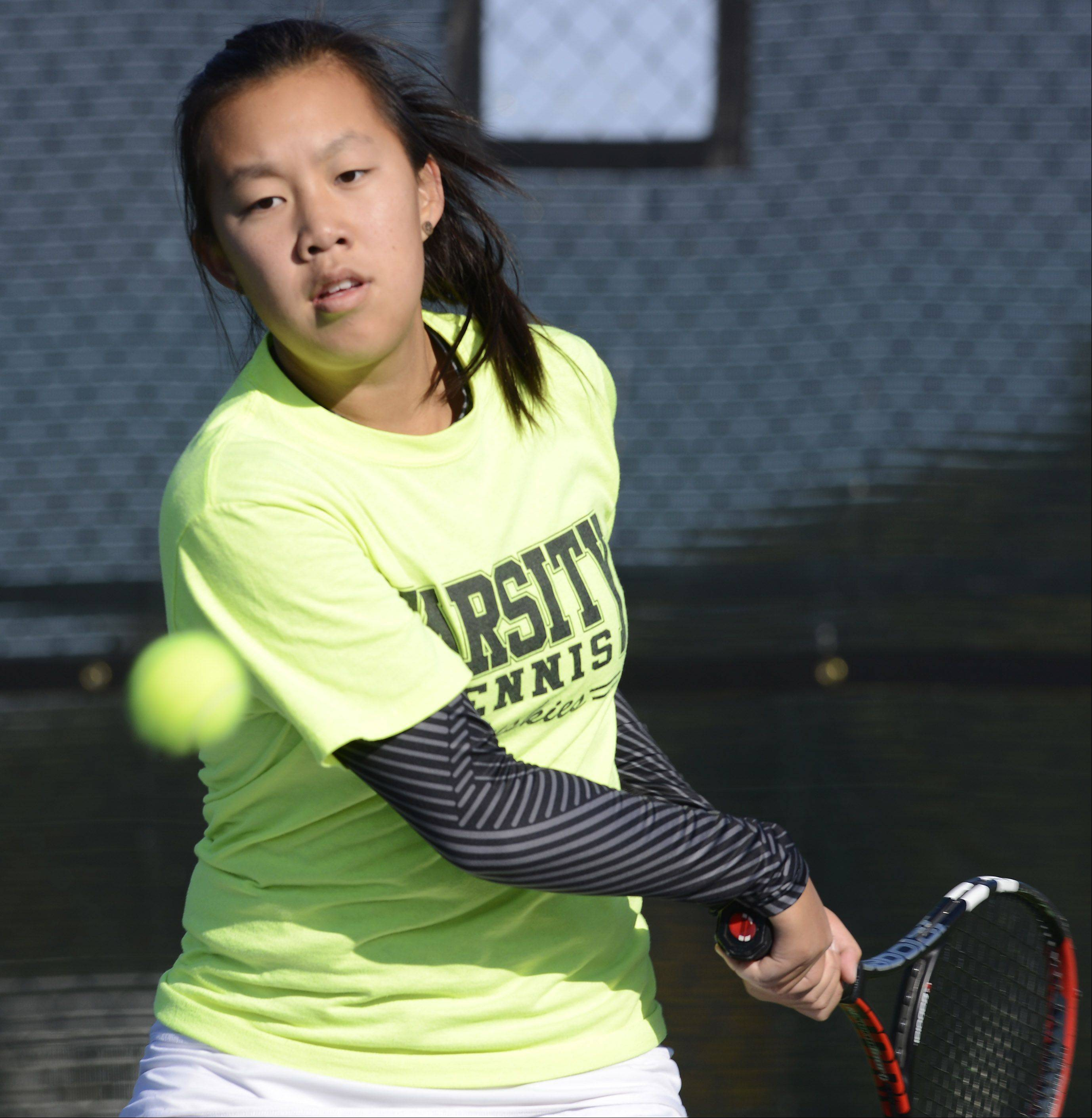 Naperville North's Jessica Hu returns a serve during doubles play at the girls state tennis preliminaries at Prospect High School Thursday.