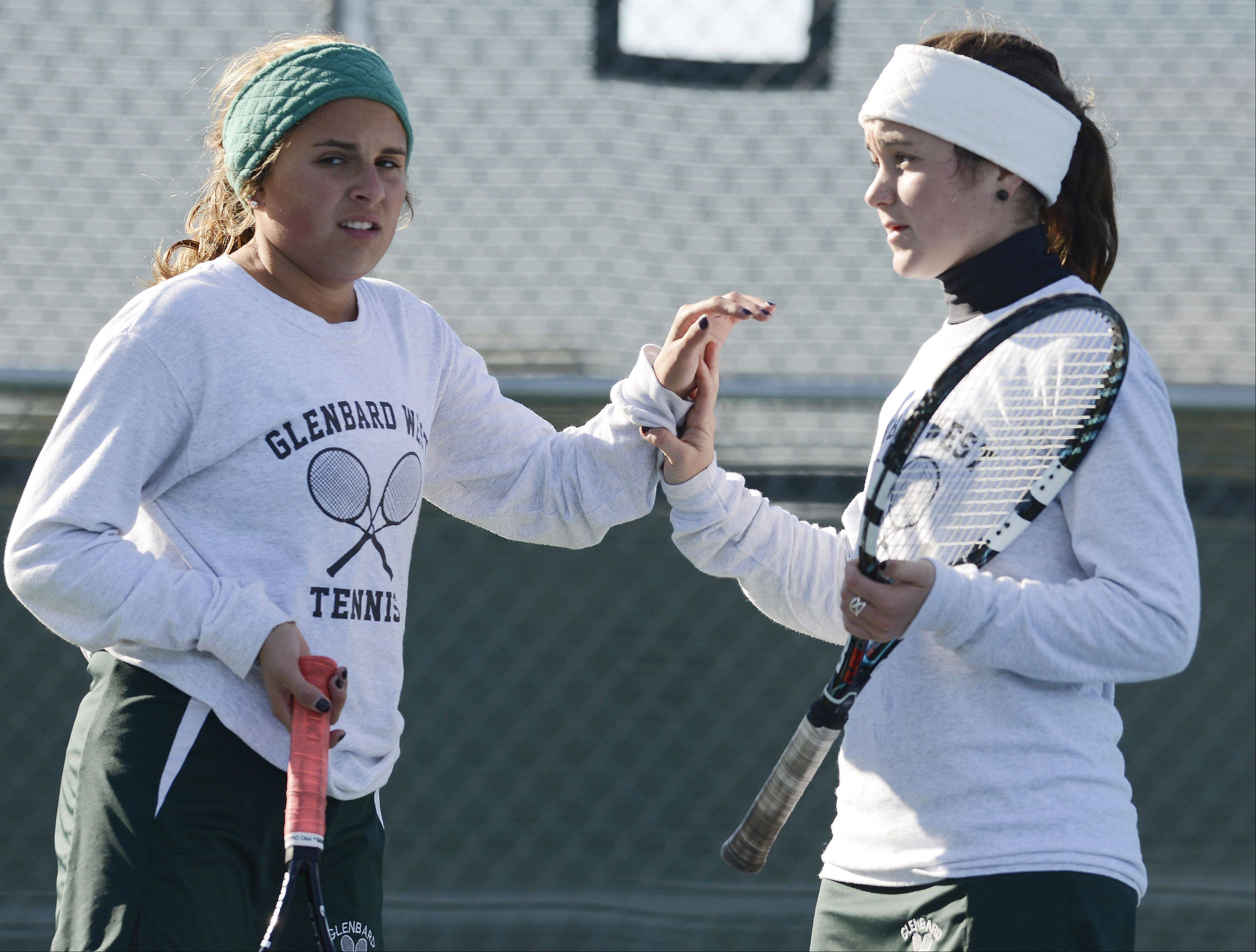 Glenbard West's Maggie Hughes, left, and Elizabeth Ficarella congratulate one another after a point during the girls state tennis preliminaries at Prospect High School Thursday.