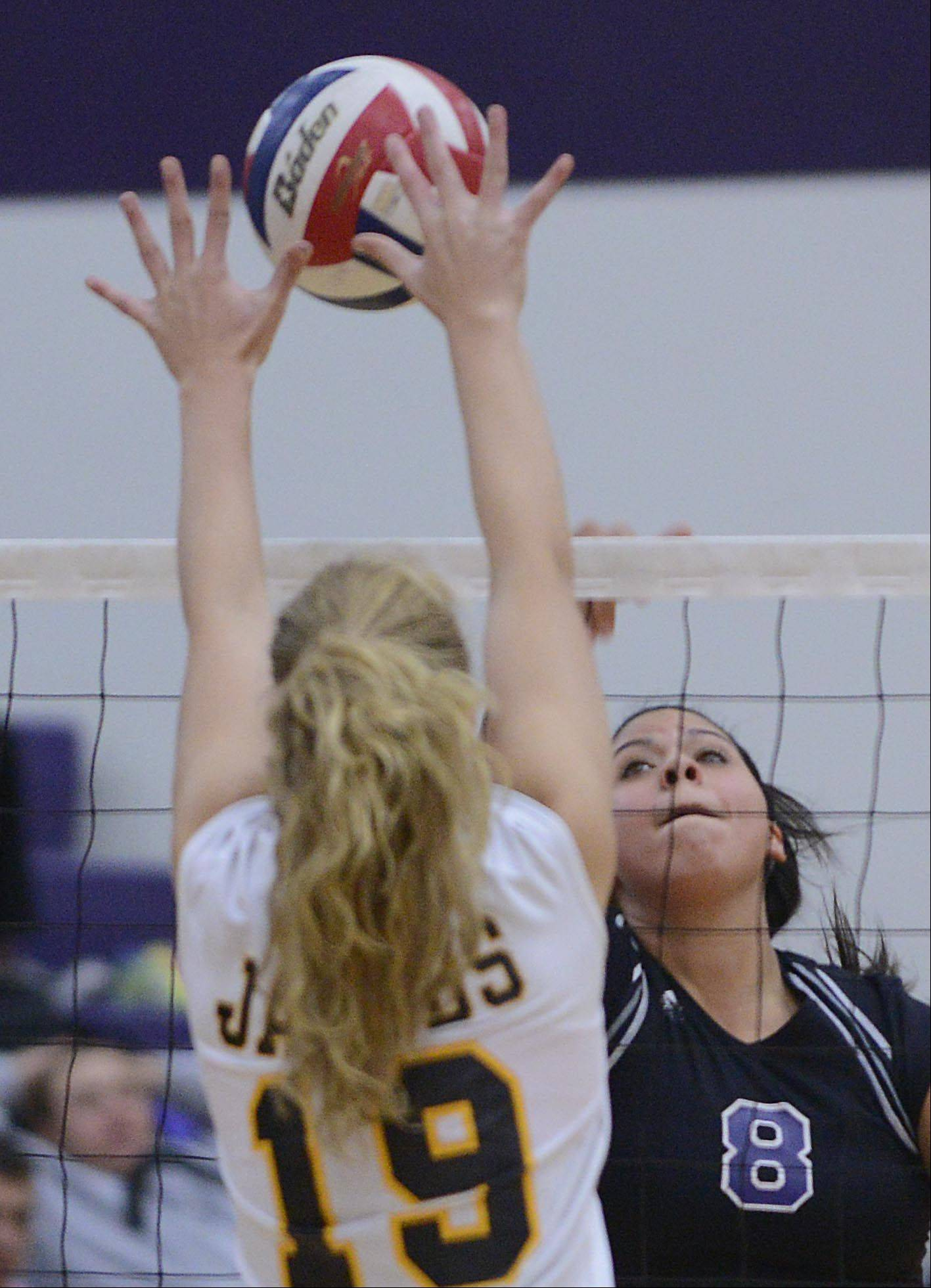 Hampshire's Caitlin Conlon hits into the defense of Jacobs' Kyla Fitzsimmons Thursday in Hampshire.