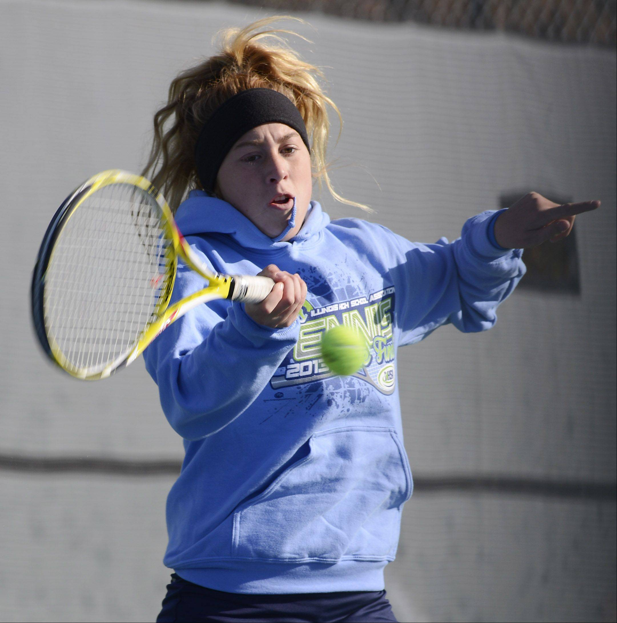 Bartlett's Gabriella Gregorio returns the ball during doubles play at the girls state tennis preliminaries at Prospect High School Thursday.