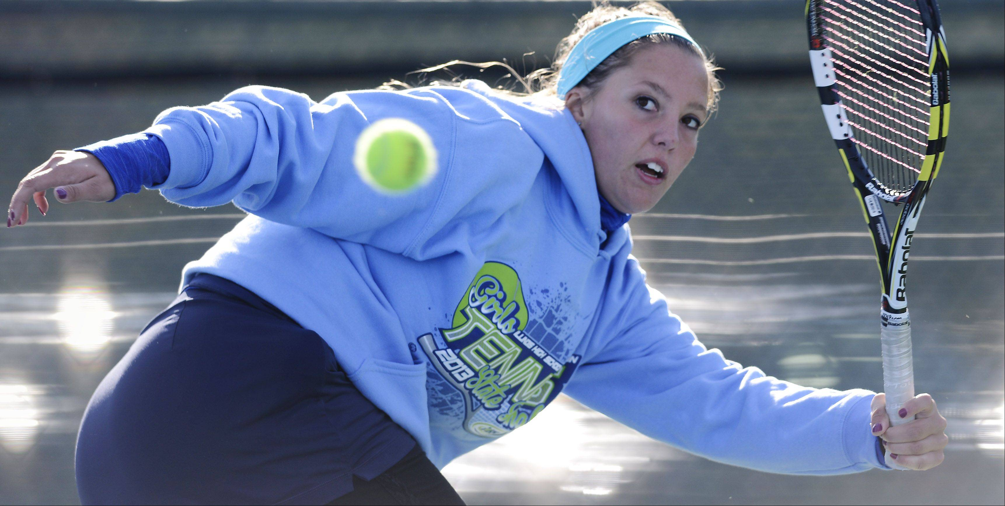 Bartlett's Jennifer Gates reaches back to return a volley during the girls state tennis preliminaries at Prospect High School Thursday.