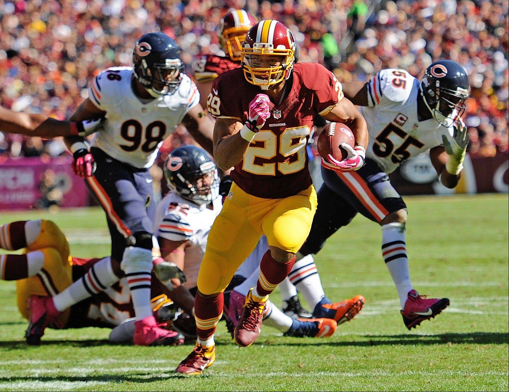 Washington running back Roy Helu breaks free and heads toward the end zone for a touchdown during the first half of a NFL game against the Bears in Landover, Md., Sunday.