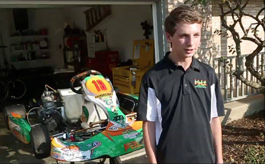 Four-time national champion go-kart racer Kyle Kalish with one of his karts at his Wauconda home.