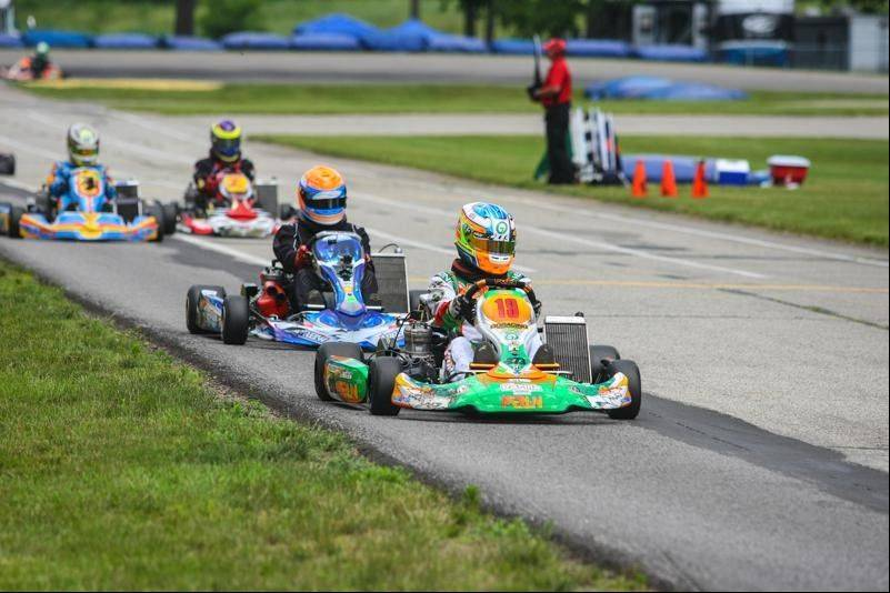 Kyle Kalish, a four-time national champion go-kart racer, leads the pack at a recent race. The Mundelein High School junior's dream is to be a professional race car driver, but he's also an outstanding student with plans to attend college after graduation.