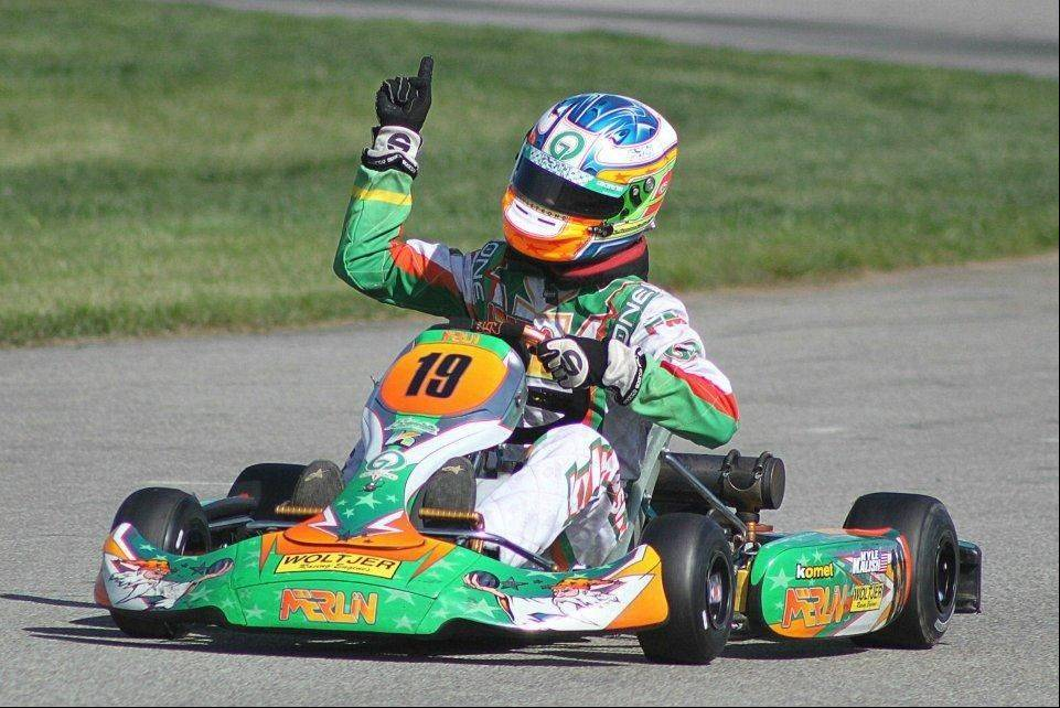 Kyle Kalish, a four-time national champion go-kart racer, celebrates after winning a race last year at the Pittsburgh International Race Complex. The Mundelein High School junior's dream is to be a professional race car driver.