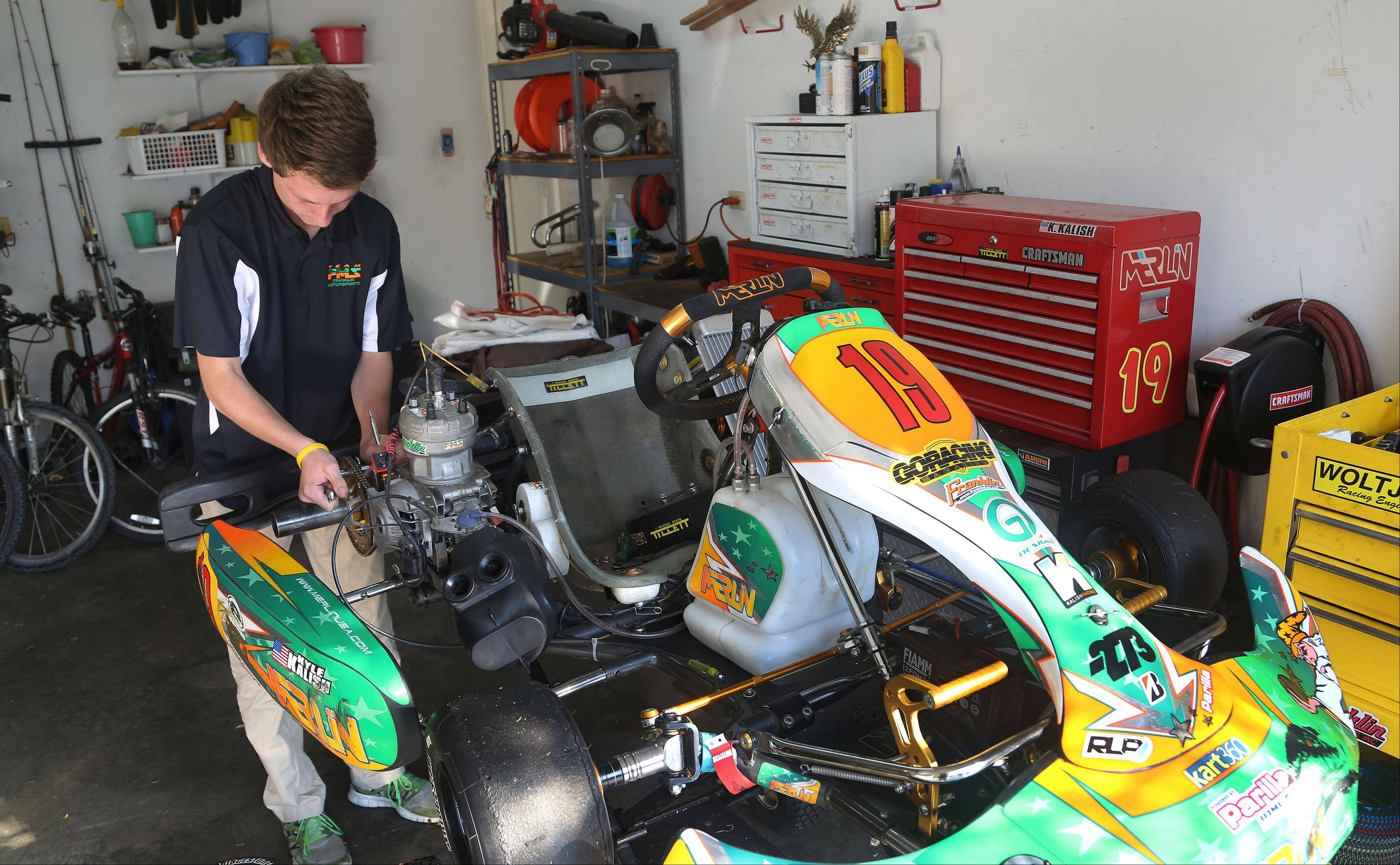 Four-time national champion go-kart racer Kyle Kalish works on his kart at home in Wauconda. Kyle, a junior at Mundelein High School, hopes to become a professional race car driver and is an outstanding student with plans to attend college.