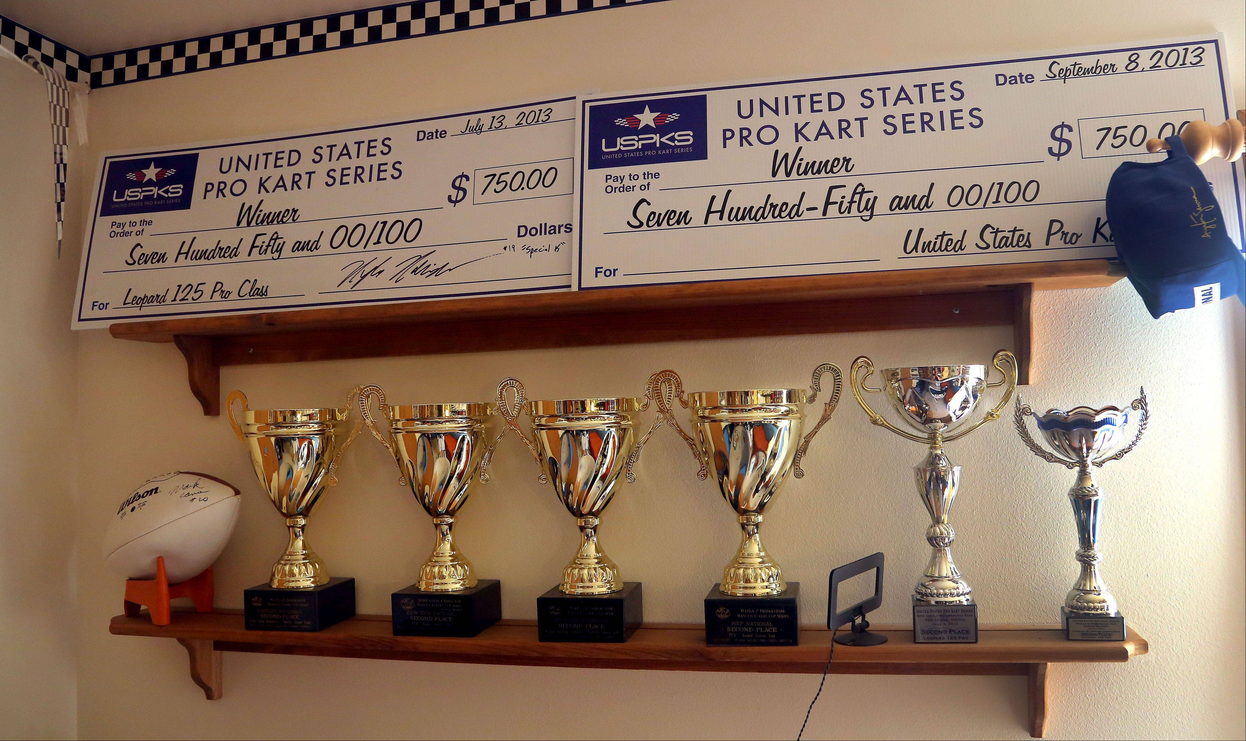 Four-time national champion go-kart racer Kyle Kalish's home in Wauconda is decorated with trophies from racing wins.