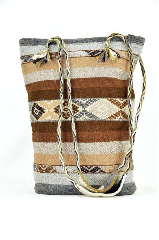 Woven by artisans from the Cusco Center for Traditional Textiles in the village of Sallac, Peru, each sling-handled alpaca tote is made by Quechua-speaking artisans.