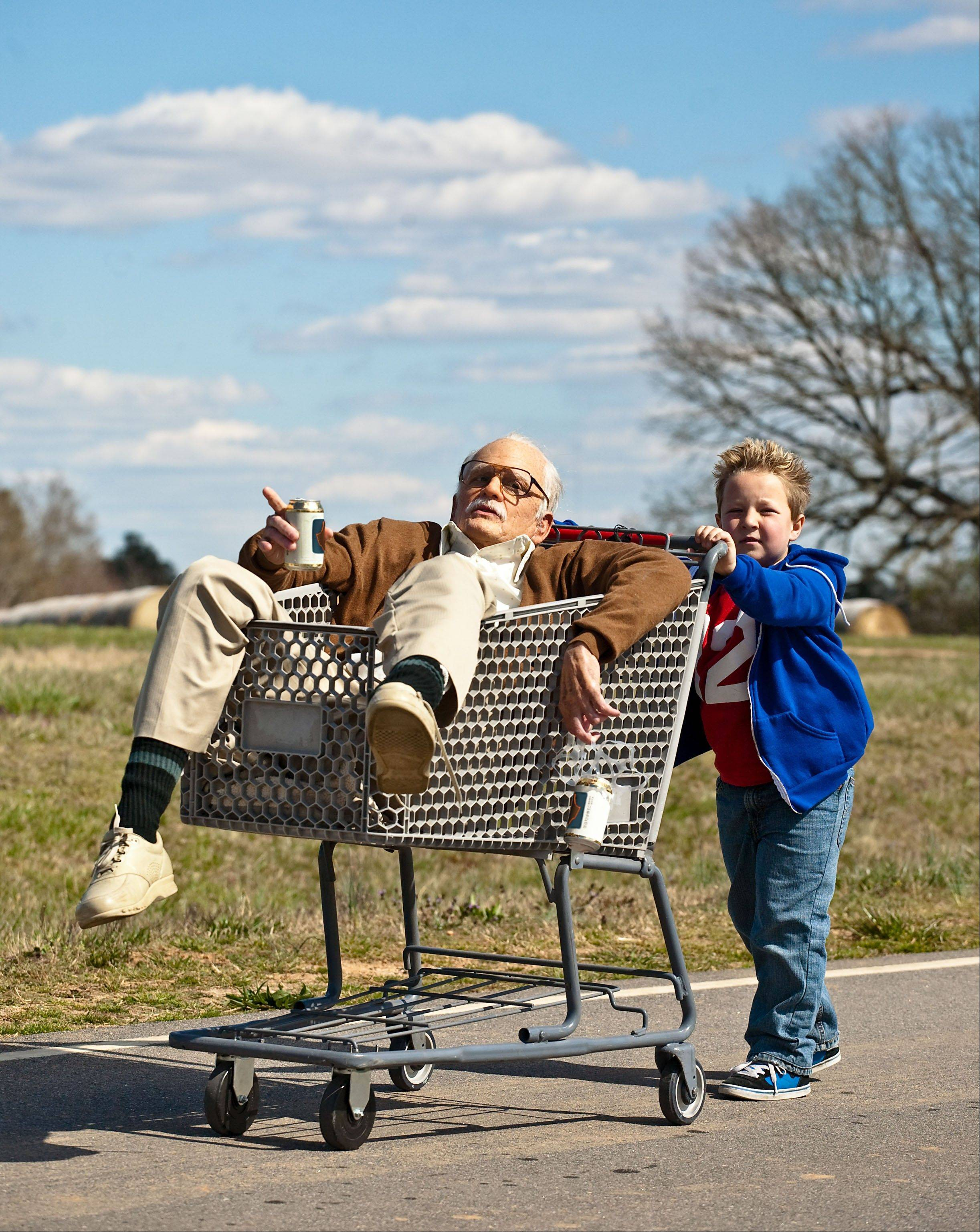 "Billy (Jackson Nicoll, right) gives his grandfather (Johnny Knoxville) a lift in ""Jackass Presents: Bad Grandpa."""