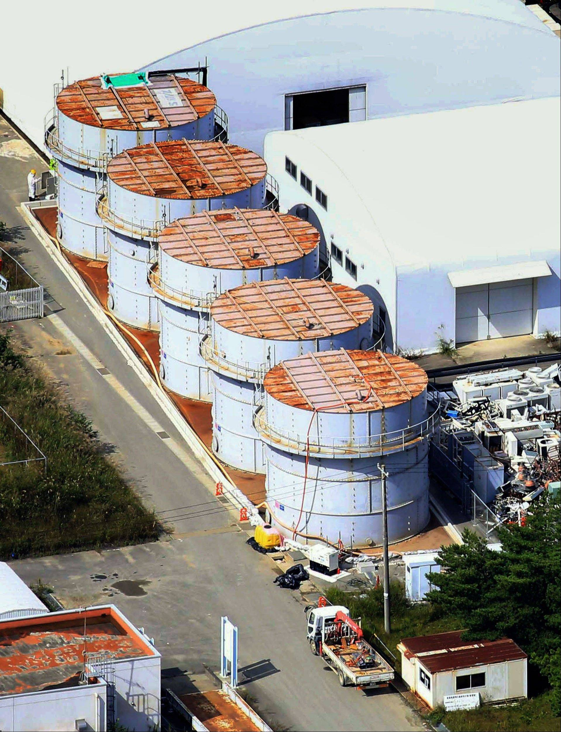 The storage tank, bottom, which workers detected the water dripping from the top, at the Fukushima Dai-ichi nuclear plant at Okuma town in Japan. The operator of the Fukushima plant has ordered workers near the coast to move to higher ground.