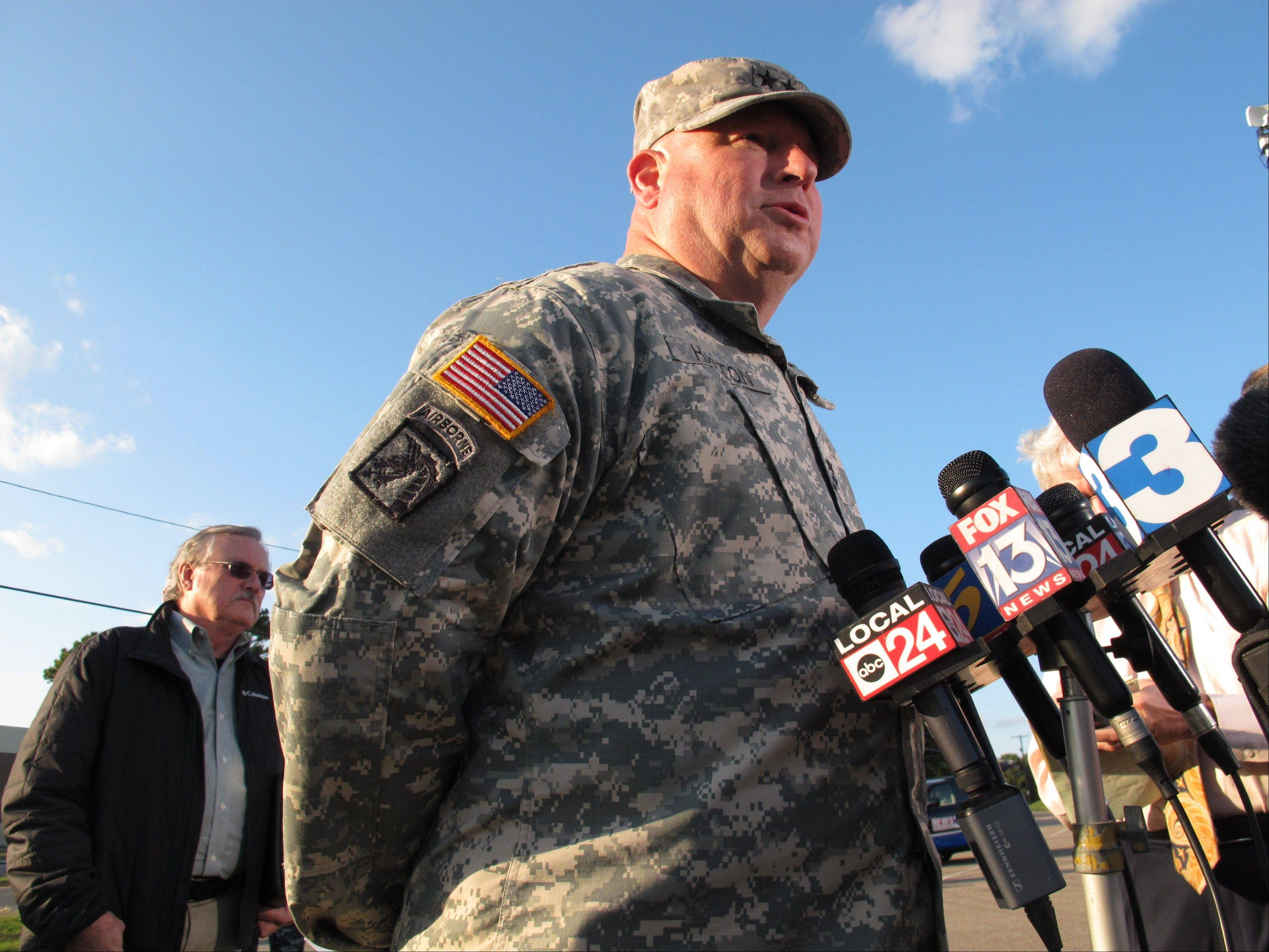 Maj. Gen. Max Haston, right, Adjutant General of the Tennessee National Guard, speaks at a news conference near a Guard armory where two Guard members were shot Thursday in Millington, Tenn. At left is Tennessee National Guard spokesman Randy Harris.