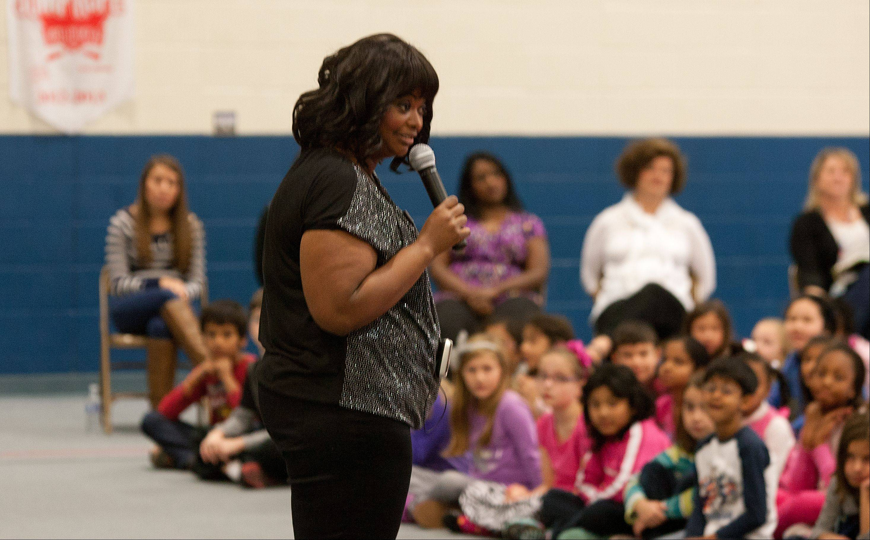 "Actress and author Octavia Spencer speaks to students Thursday at Young Elementary School in Aurora. The Oscar-winning actress, who was in the area to promote her new children's book, urged students to ""pay attention to everything"" and ""dream big."""