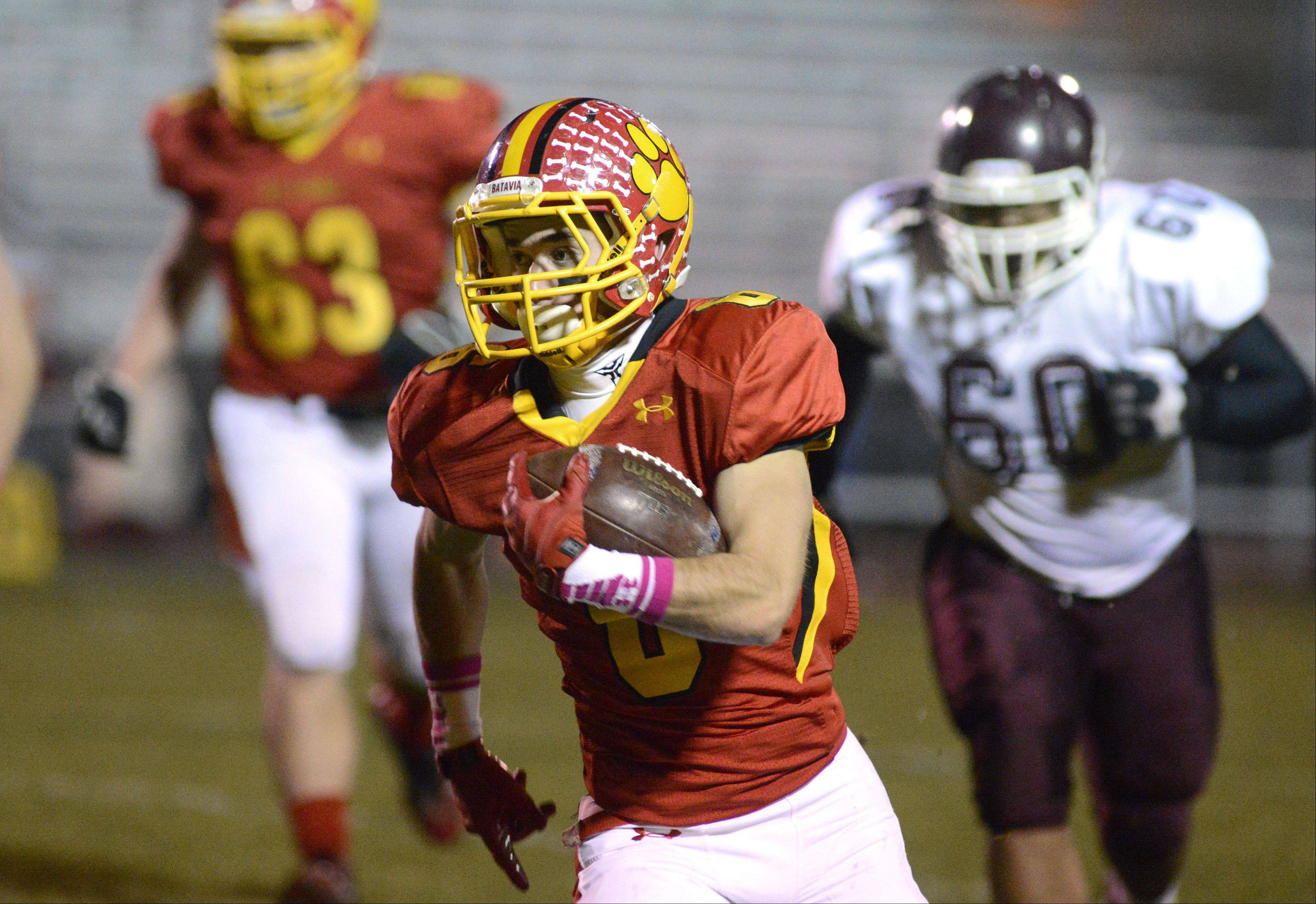 Batavia's Rourke Mullins score the first touchdown of the night over Elgin in the first quarter on Friday, October 25.