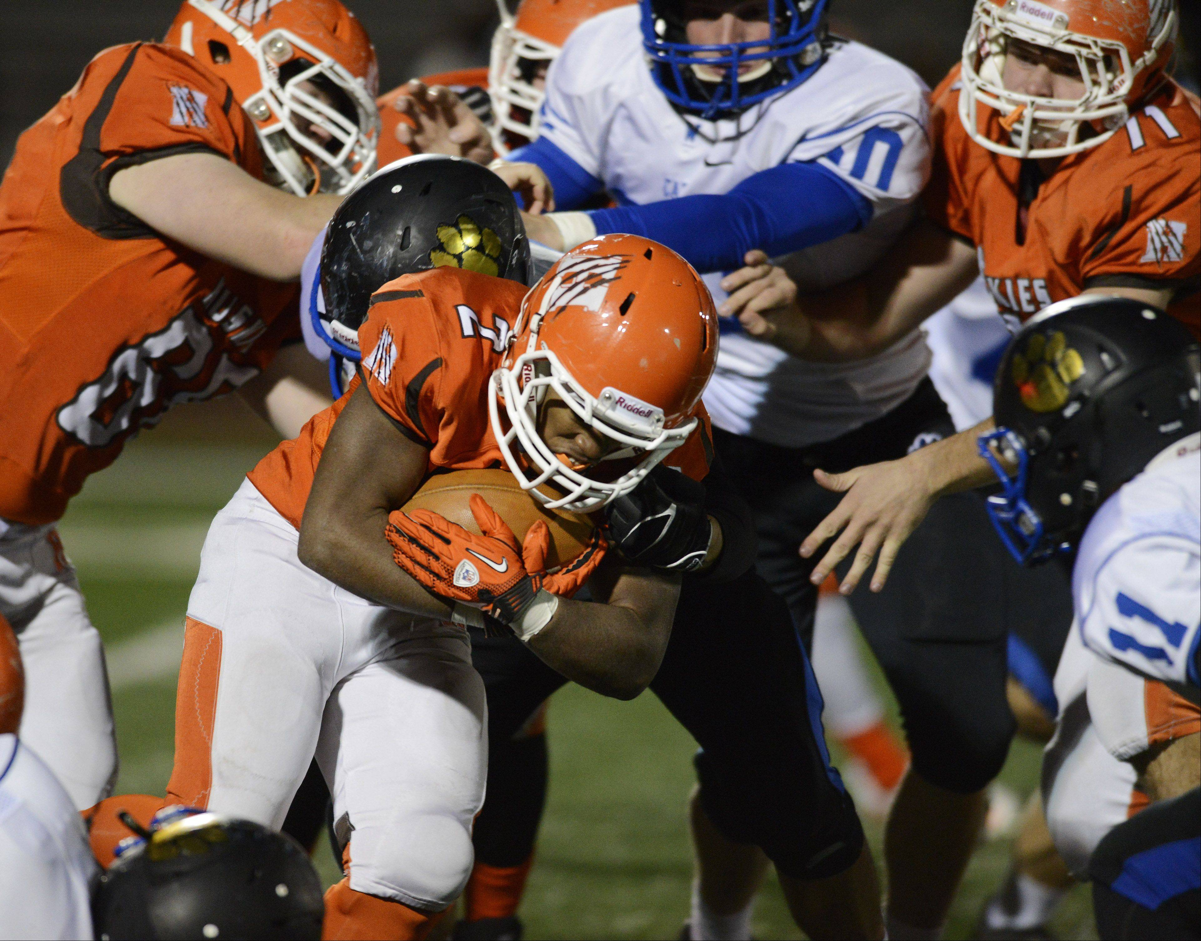 Hersey's Mario Thomas carries the ball against Wheeling.